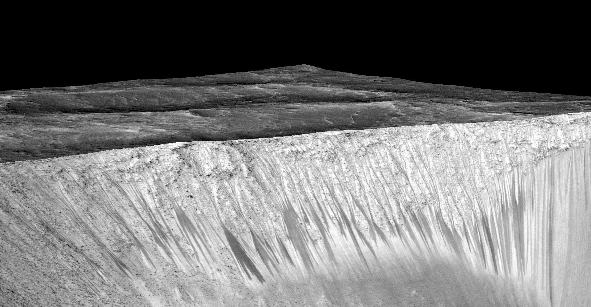 A 3-D computer model (a digital terrain map) of the walls of Garni Crater on Mars based on stereo information from two HiRISE observations showing dark, narrow streaks on the Martian slopes that are inferred to be formed by seasonal flow of water on contemporary Mars.