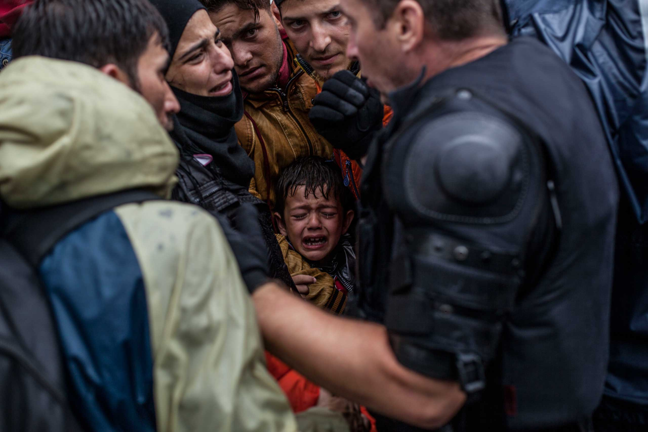 A Syrian refugee boy cries while he and his family try to board a train at the station in Tovarnik, Croatia, on Sept. 20, 2015.