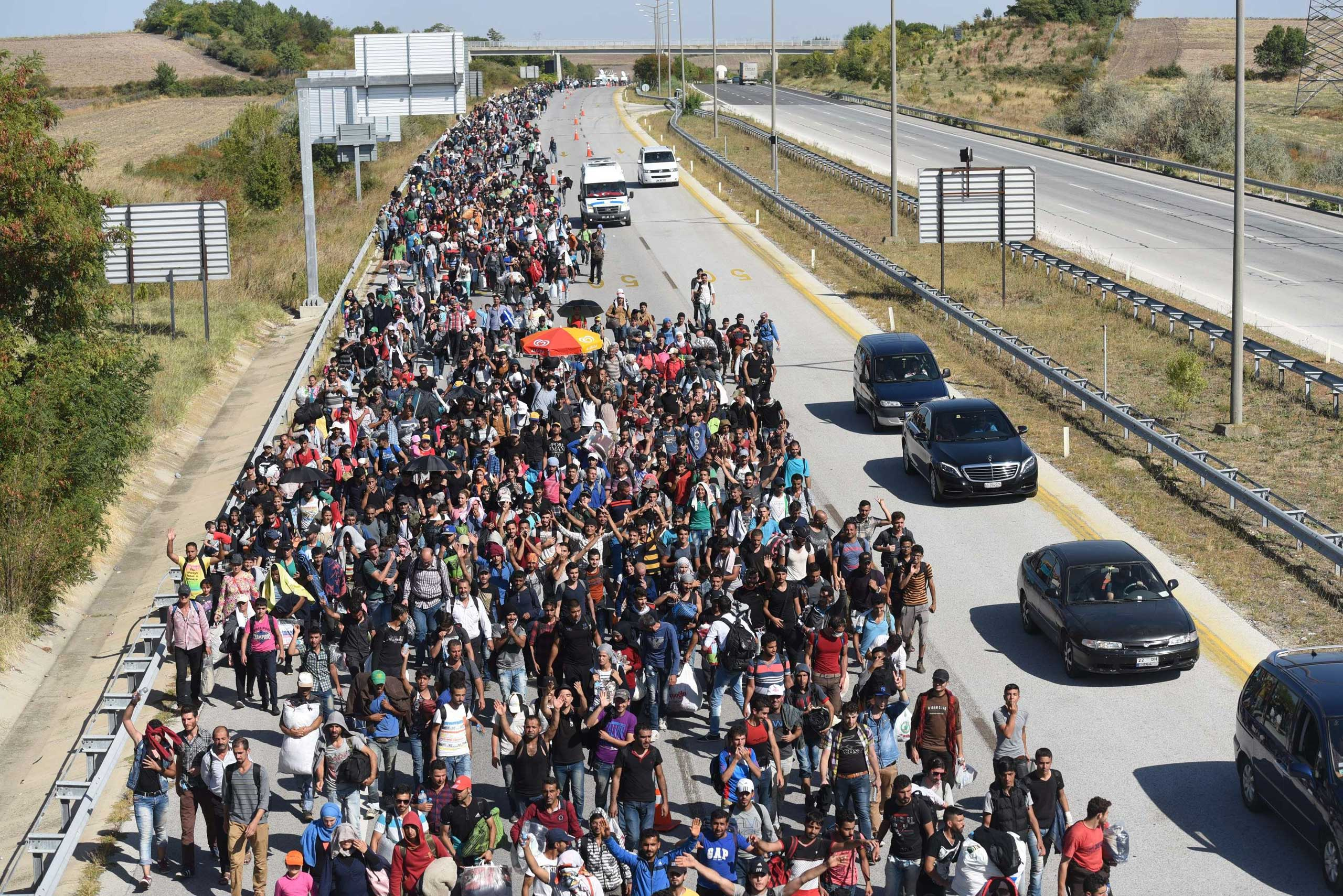 Syrian migrants and refugees march towards the border between Turkey and Greece, in Turkey, on Sept. 18, 2015.