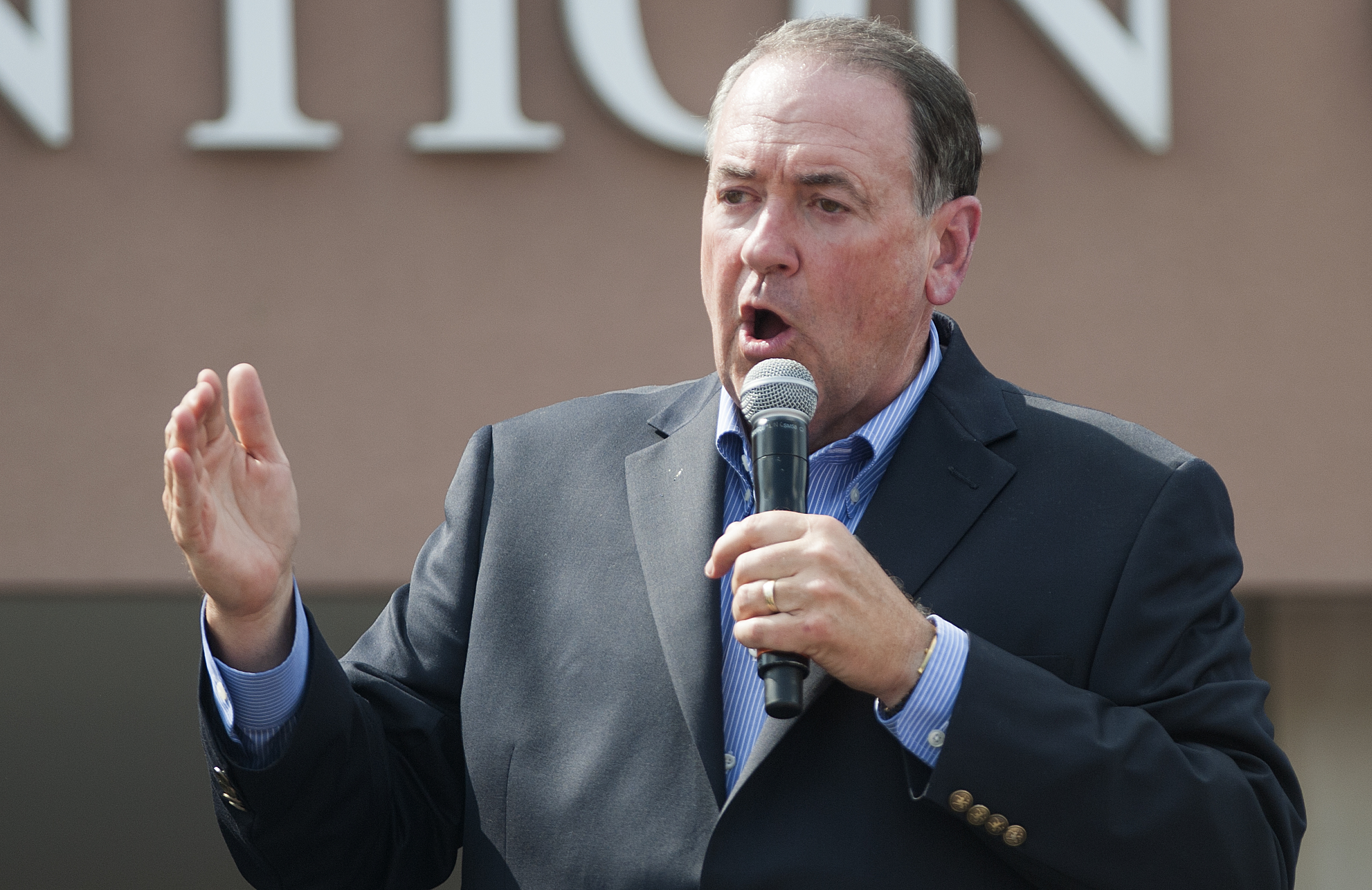 Republican presidential candidate Mike Huckabee speaks to supporters during a rally for County Clerk Kim Davis in front of the Carter County Detention Center n Grayson, Kentucky, on Sept. 8, 2015.
