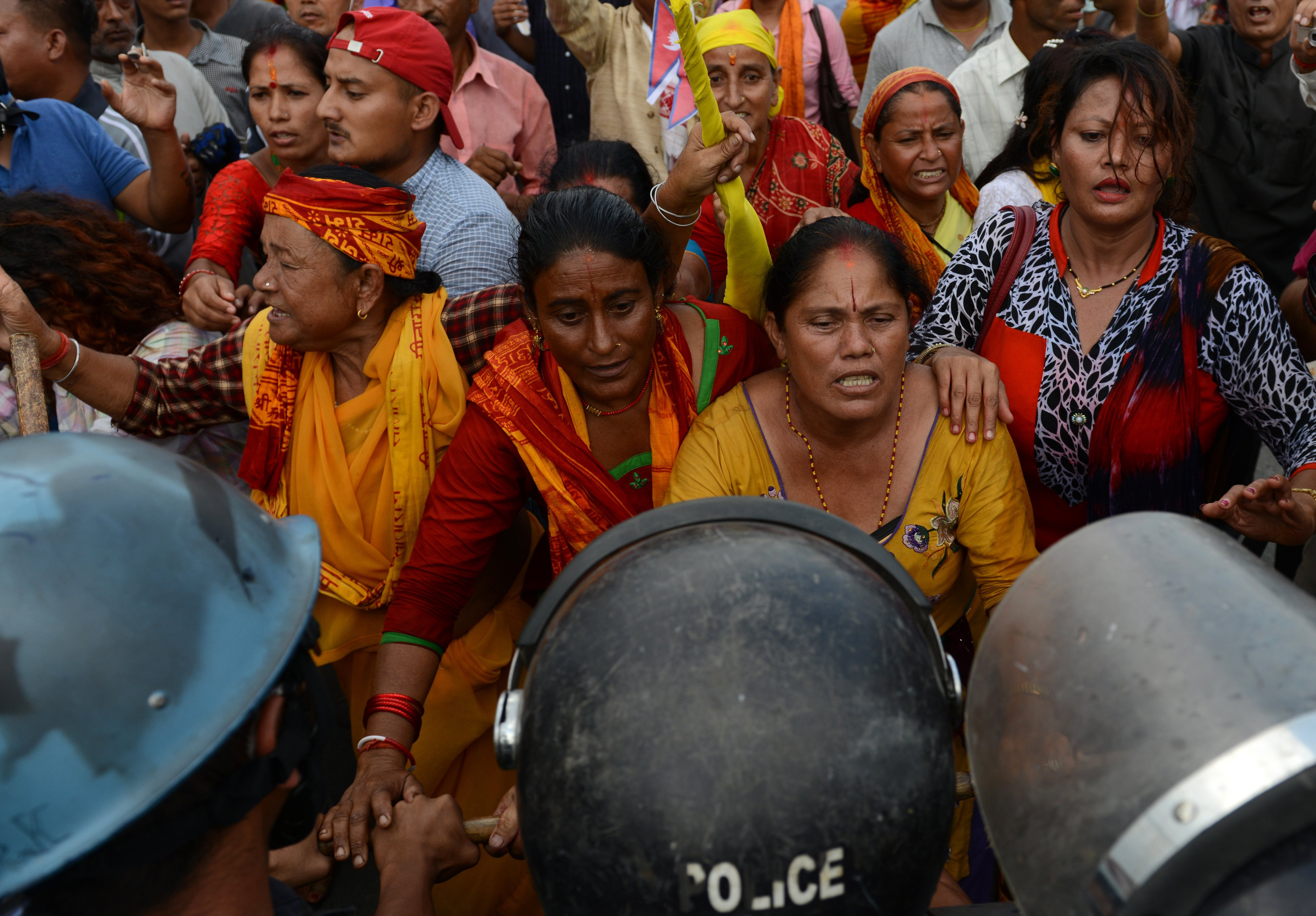 Nepalese police stop Hindu activists as they try to break through to a cordoned-off area near parliament during a protest demanding Nepal be declared a Hindu state in Kathmandu on Sept. 1, 2015