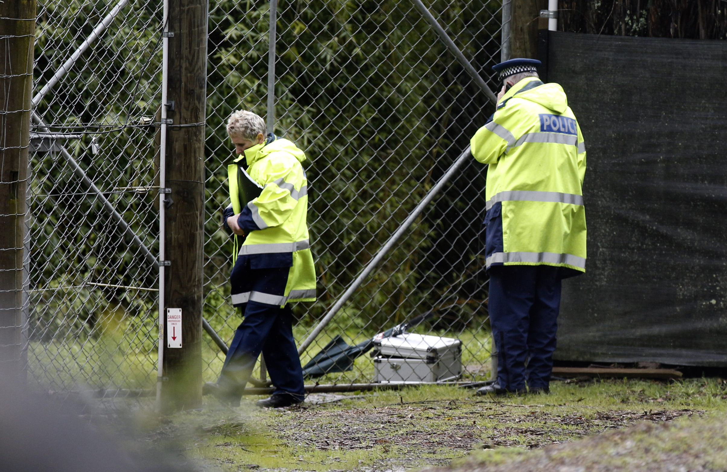 Police stand at the shut gates at Hamilton Zoo after a female zookeeper was killed by one of the tigers at the zoo in Hamilton, New Zealand, on Sept. 20, 2015