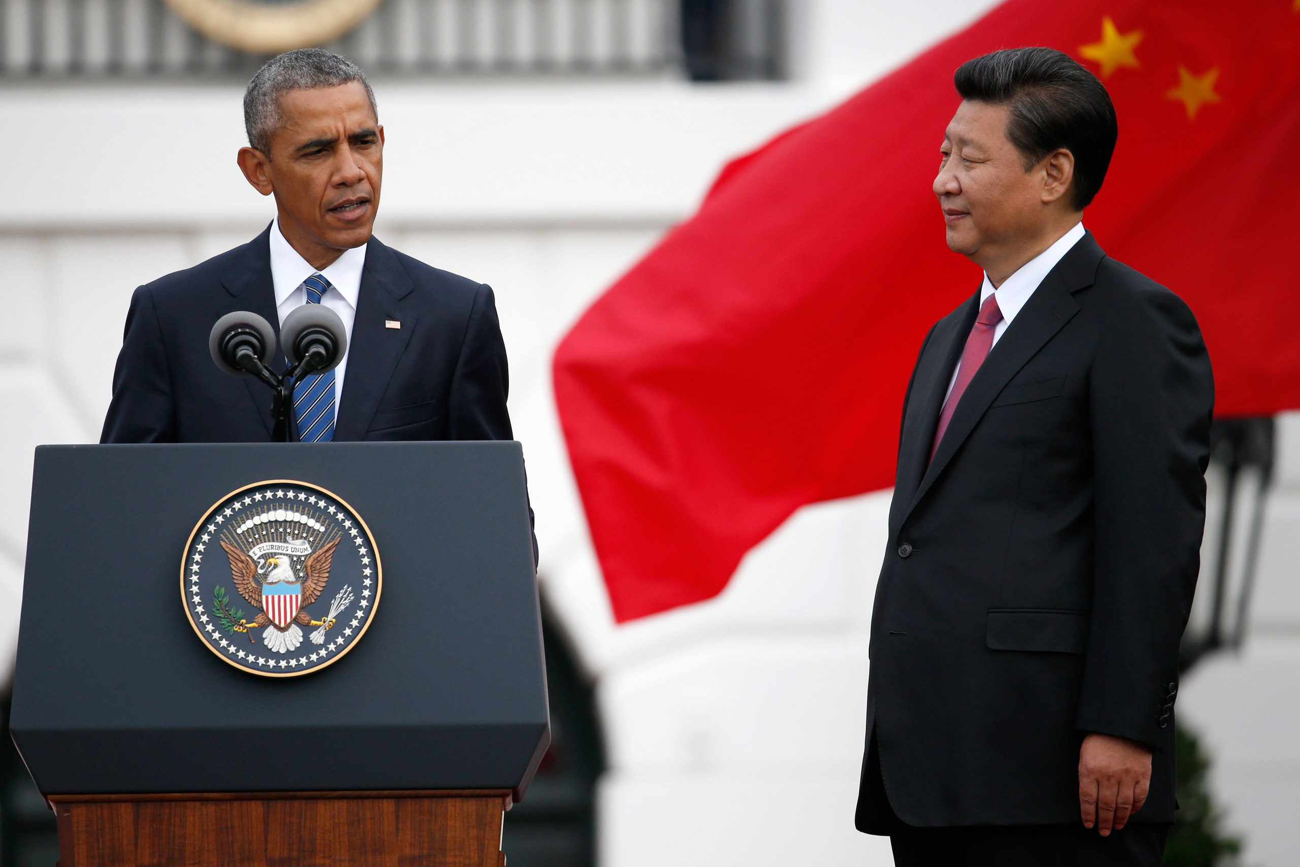 Chinese President Xi Jinping listens as President Barack Obama speaks during an official state arrival ceremony for the Chinese president at the White House in Washington on Sept. 25, 2015.