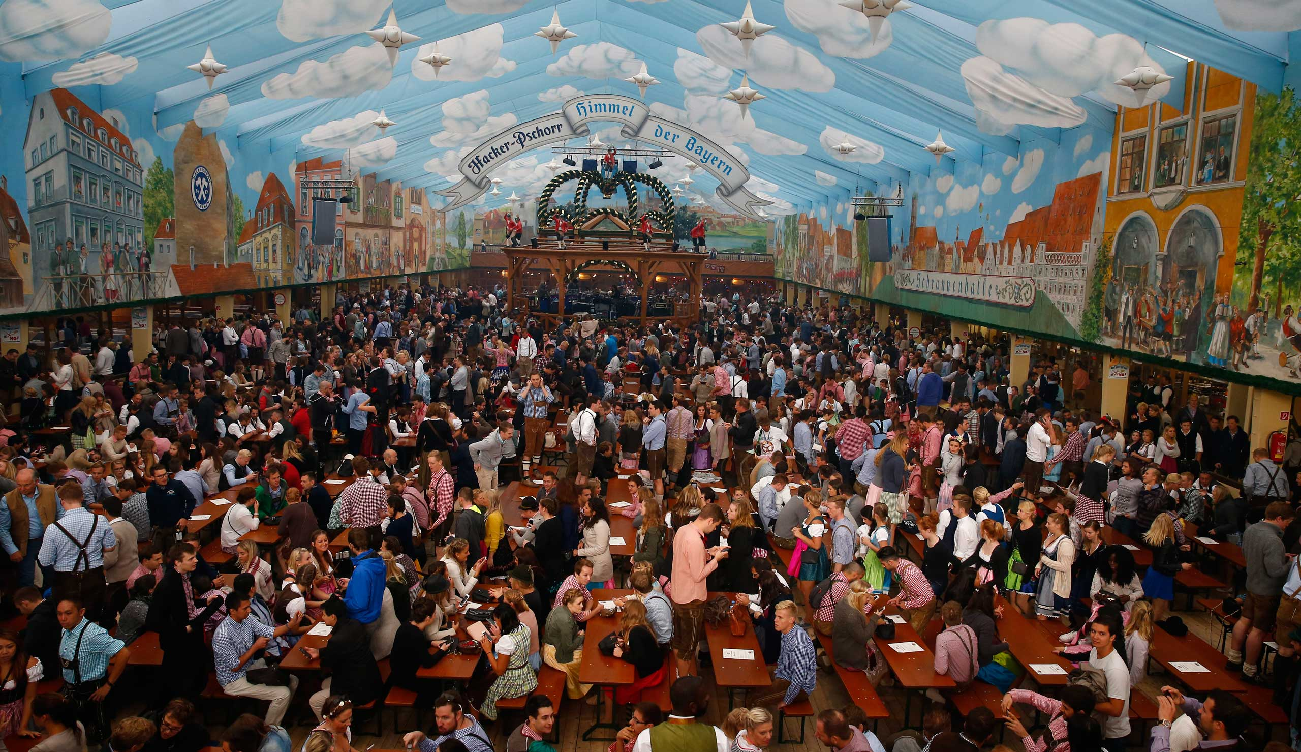 Customers fill a tent after the opening of the 182nd Oktoberfest in Munich, Germany, on Sept. 19, 2015.