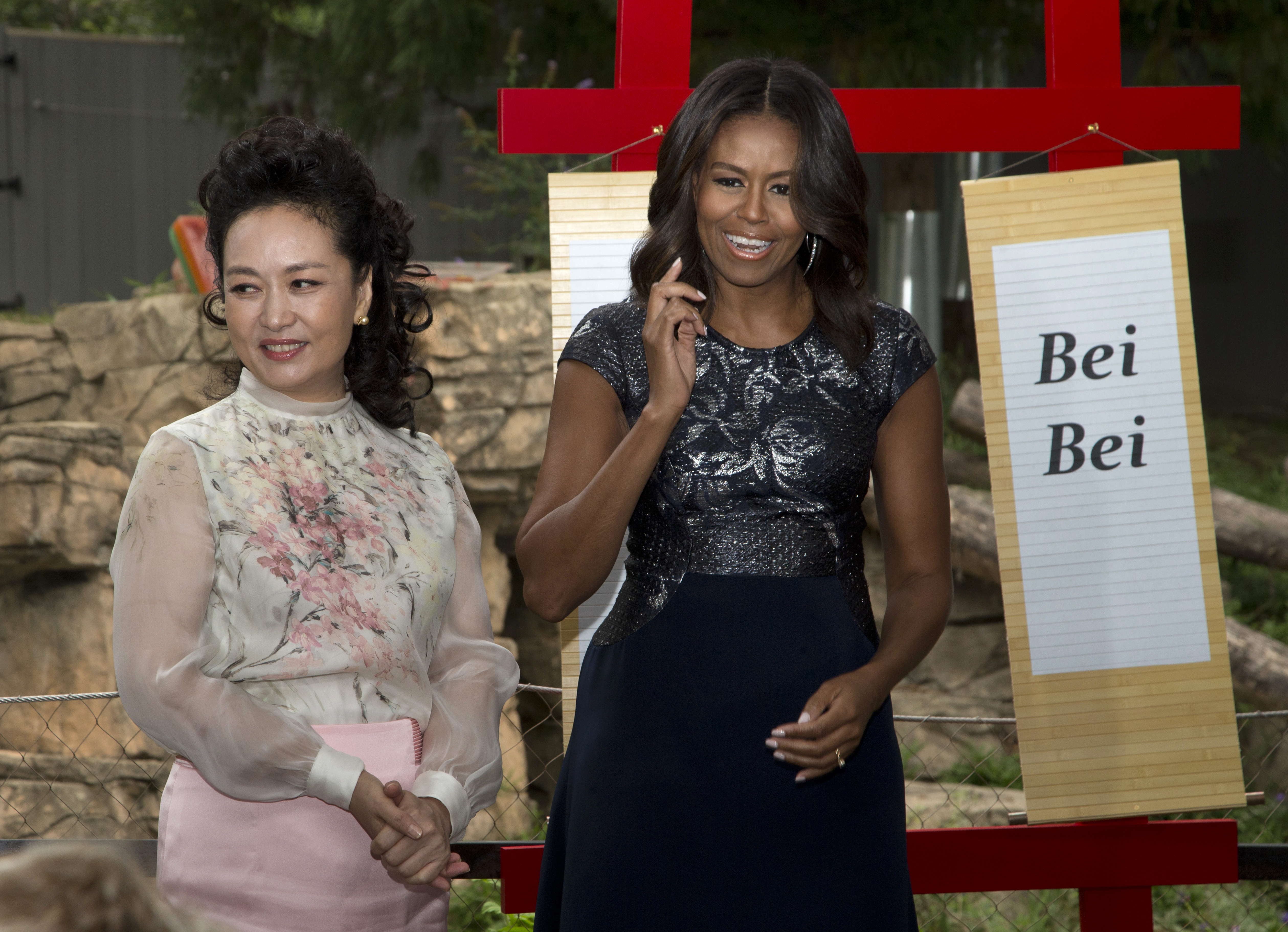 First lady Michelle Obama and China's first lady Peng Liyuan unfurled scrolls to announce panda Bei Bei's name on Sept. 22, 2015