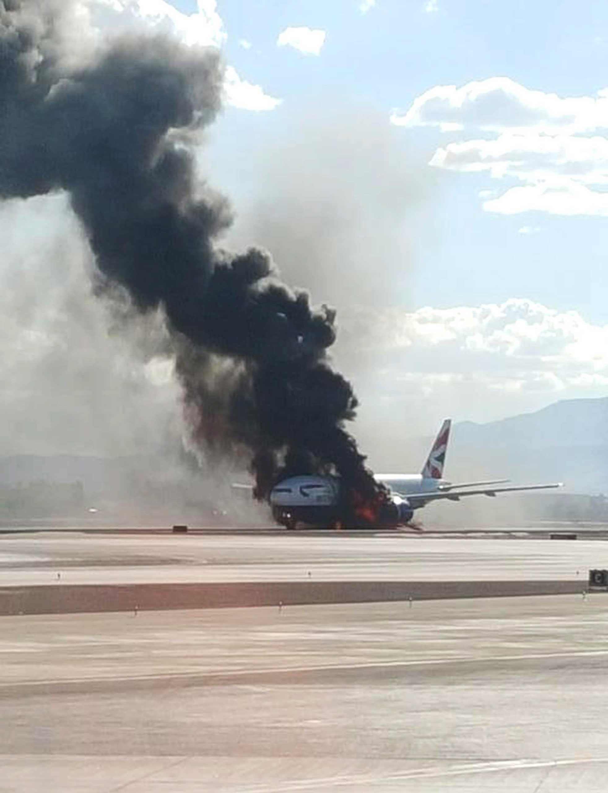 A handout photo from Twitter user Bradley Hampton used with permission shows British Airways flight 2276 en route to London's Gatwick Airport on fire at McCarran International Airport in Las Vegas, on Sept. 8, 2015.