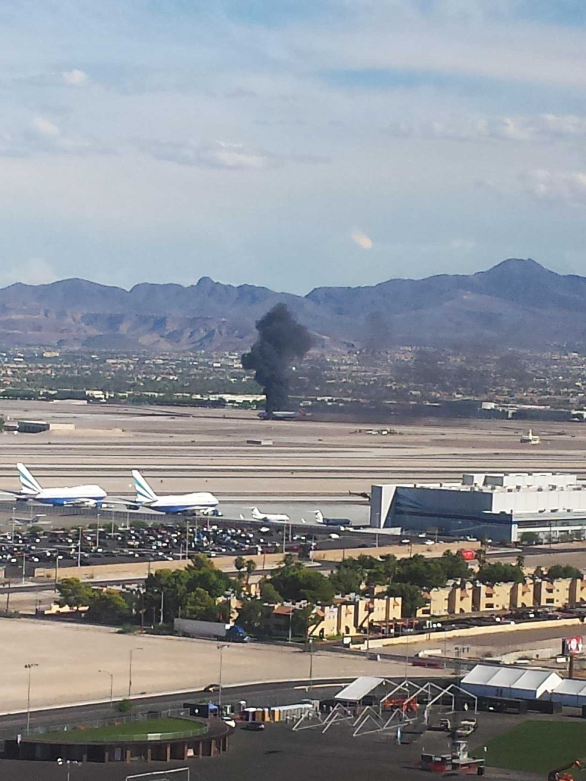 A British Airways plane seen on fire on the tarmac at Las Vegas airport on Sept. 8, 2015.