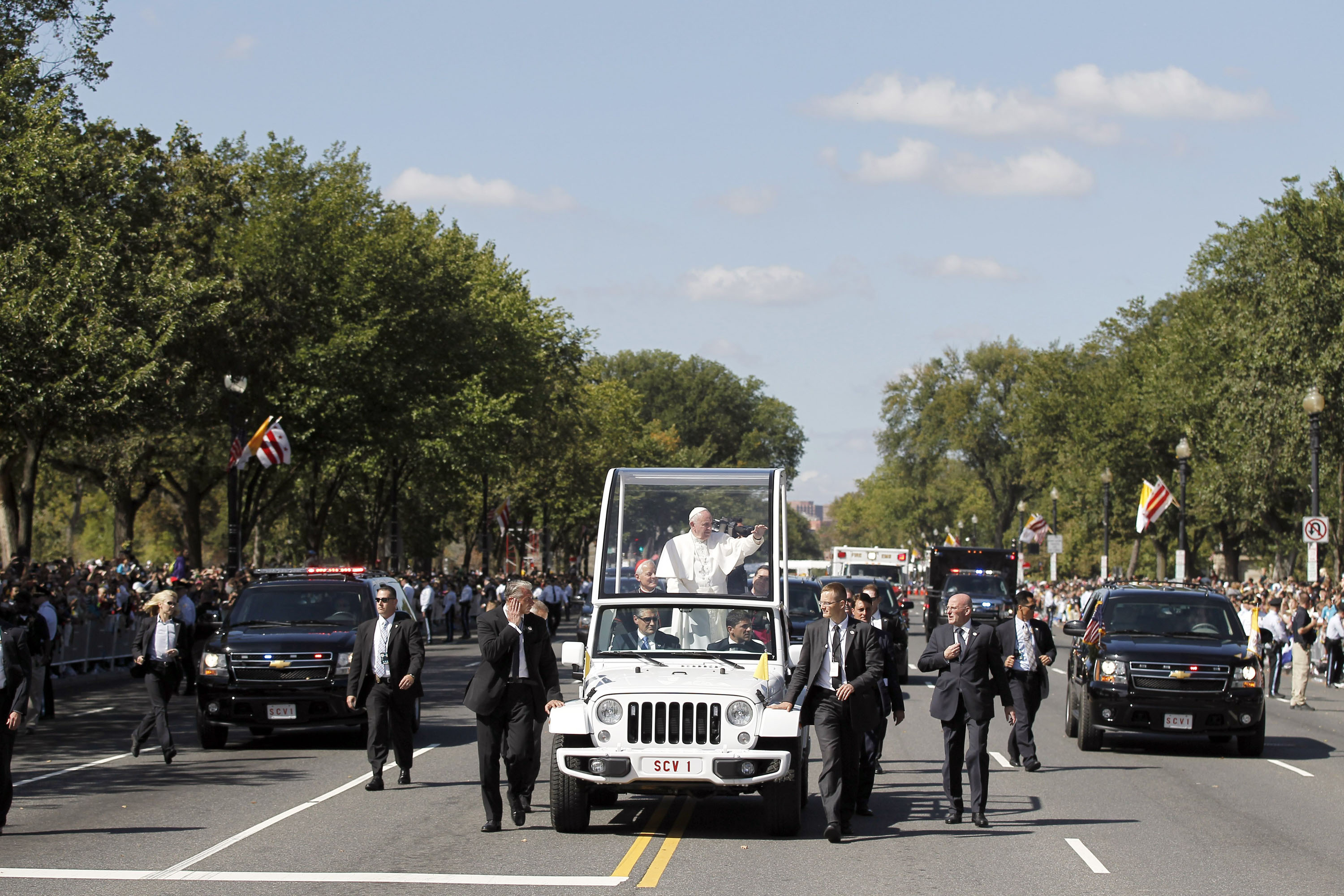 The papal parade down Washington's Constitution Avenue attracted crowds eager for a look at one man, and at history.