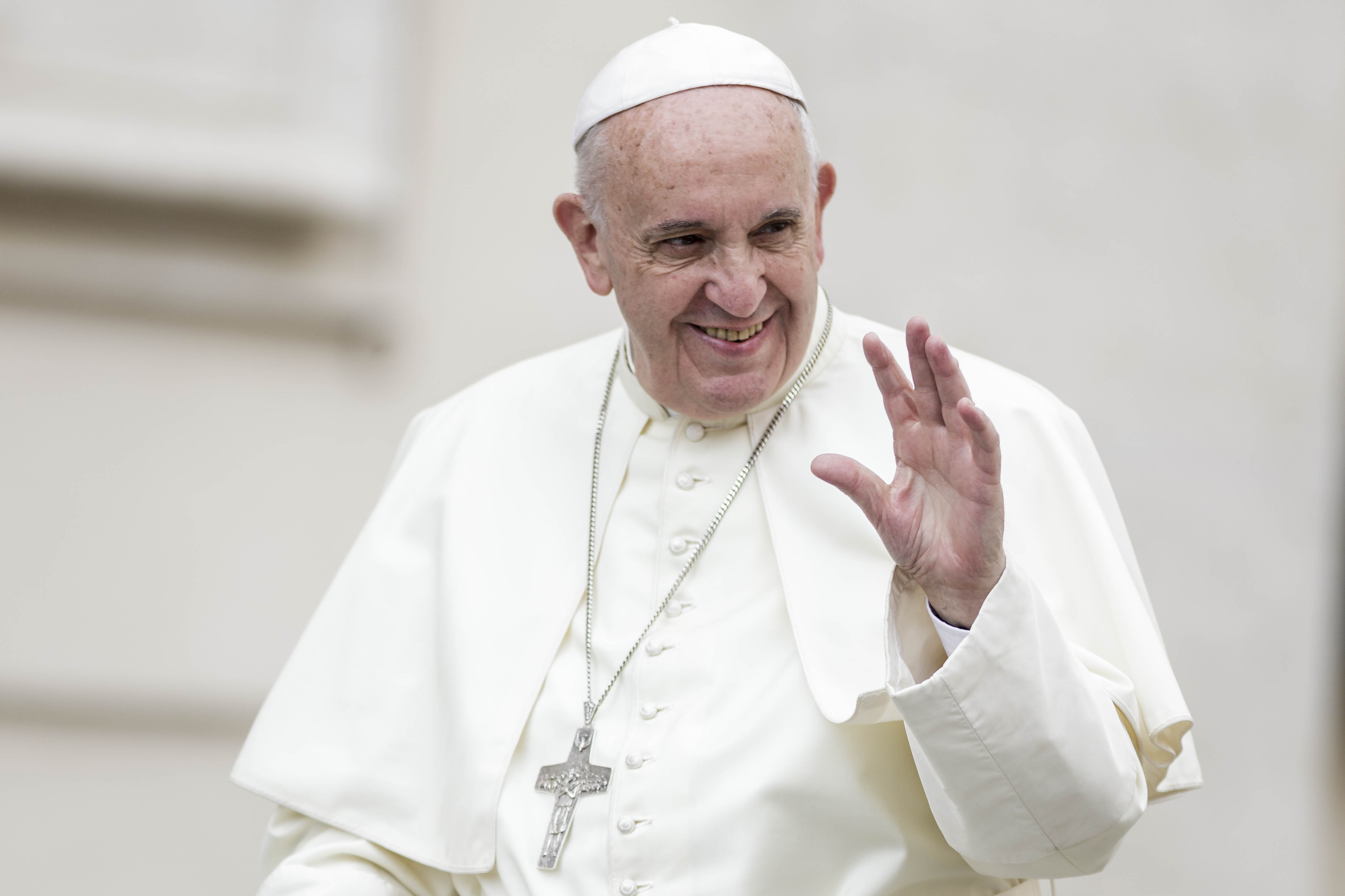 Pope Francis greets the faithful as he attends Weekly General Audience in St. Peter's Square in Vatican City.