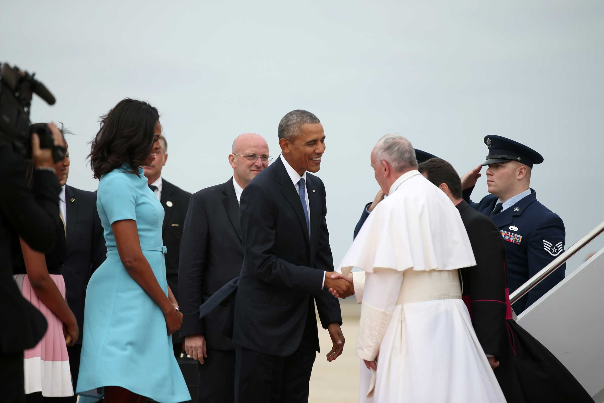 President Barack Obama, first lady Michelle Obama, and others, greet Pope Francis upon his arrival at Andrews Air Force Base, Md., on Sept. 22, 2015.