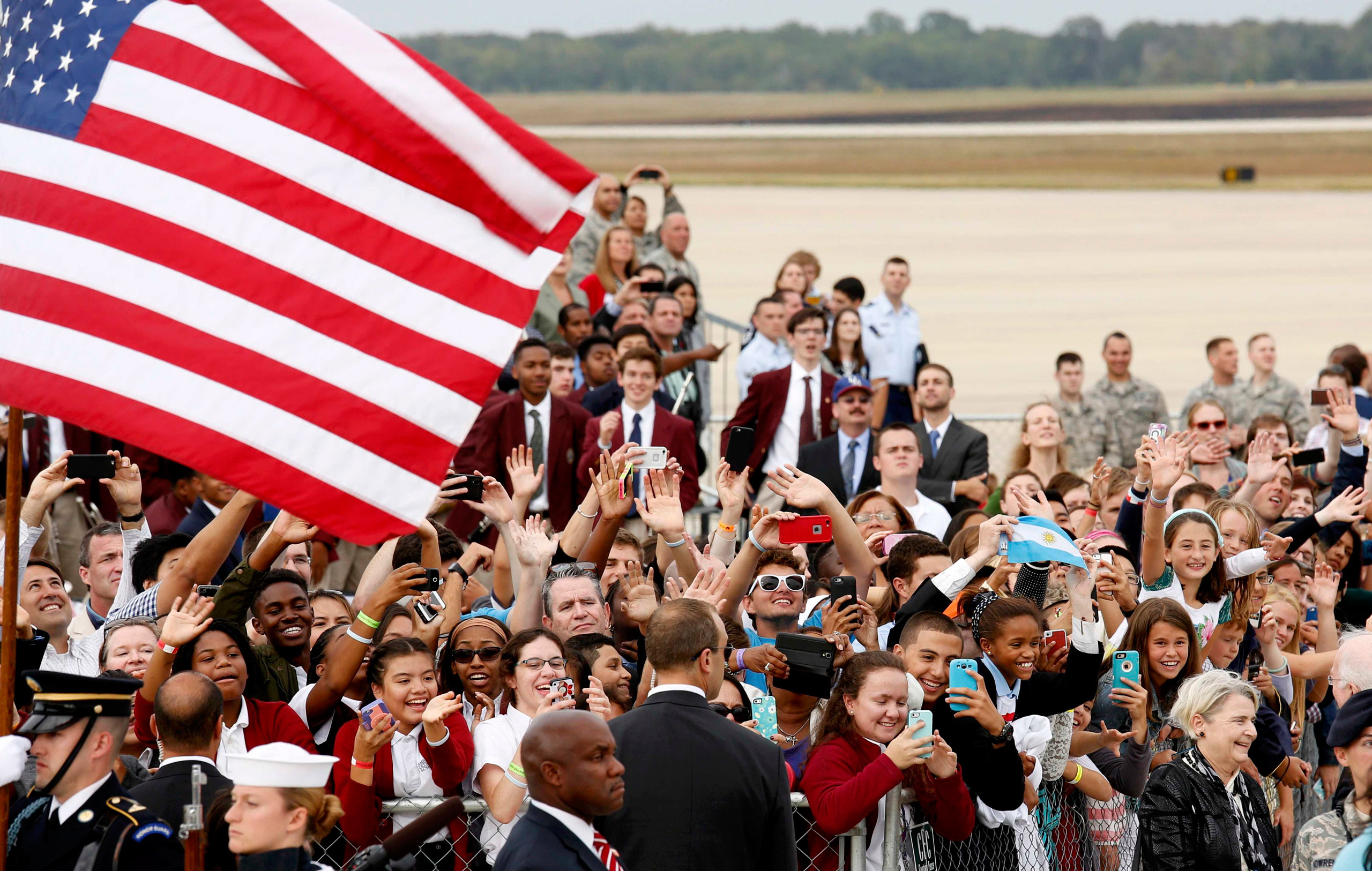 A crowd of supporters cheer as they attend the arrival of Pope Francis at Joint Base Andrews outside Washington, on Sept. 22, 2015.