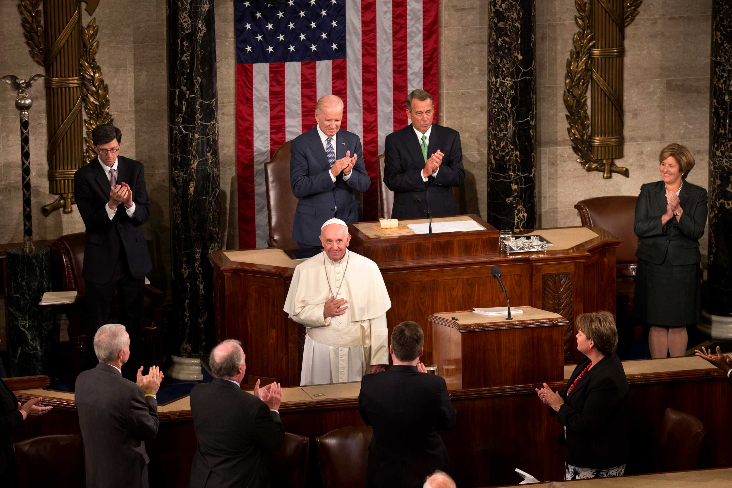 Pope Francis listens to applause before addressing a joint meeting of Congress on Capitol Hill in Washington, on Sept. 24, 2015,