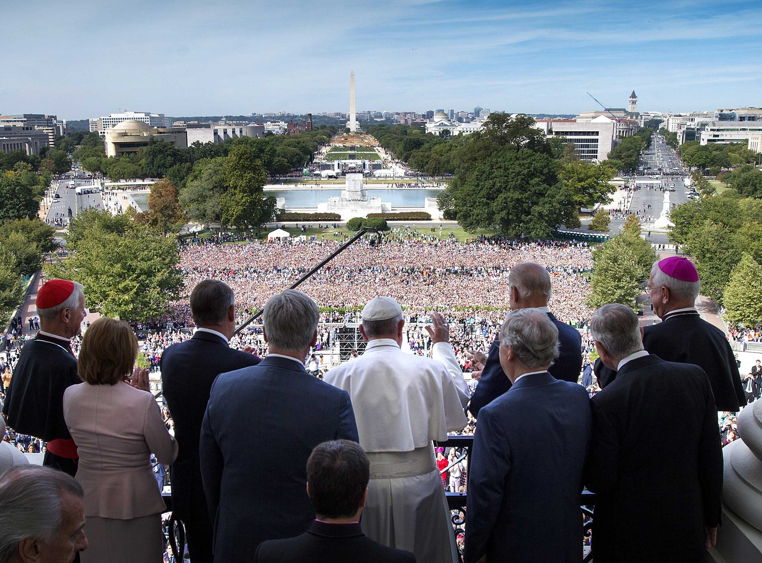 Pope Francis waves to the crowd from the Speakers Balcony at the U.S. Capitol in Washington, on Sept. 24, 2015.