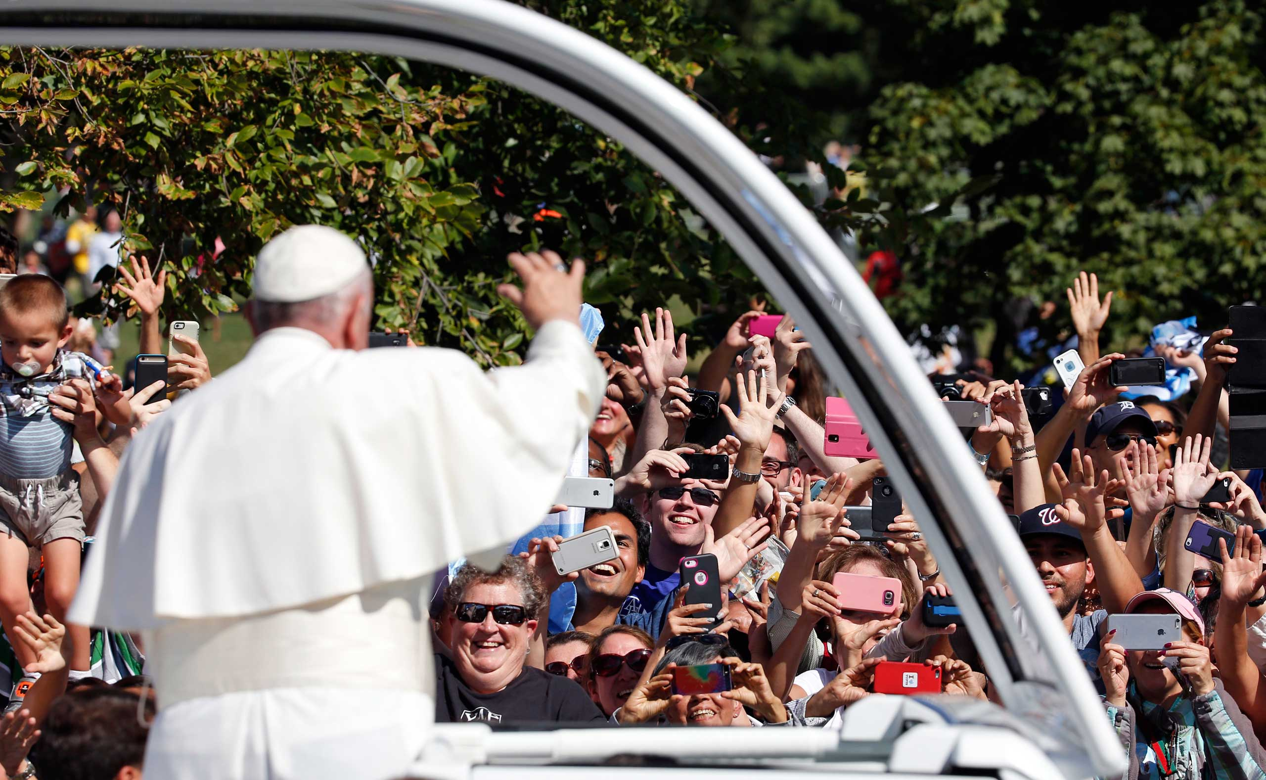 Pope Francis waves to the crowd from the popemobile during a parade in Washington, on Sept. 23, 2015.