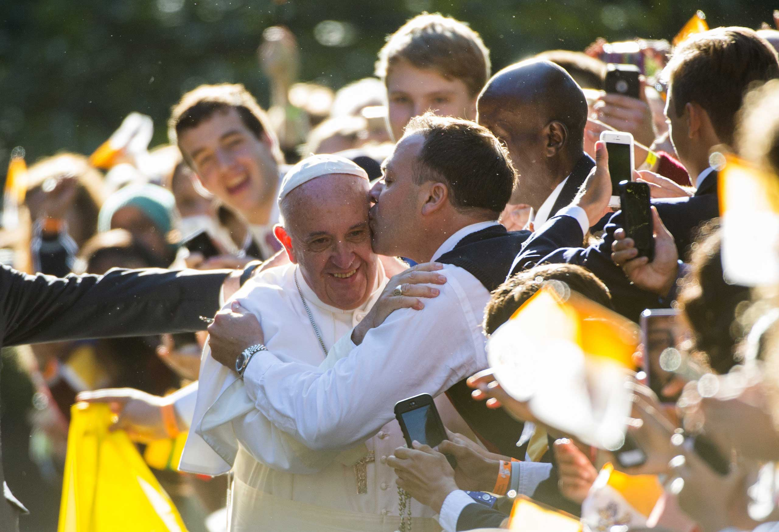 Pope Francis takereceives a kiss, outside the Apostolic Nunciature to the United States in Washington, on Sept. 23, 2015 .