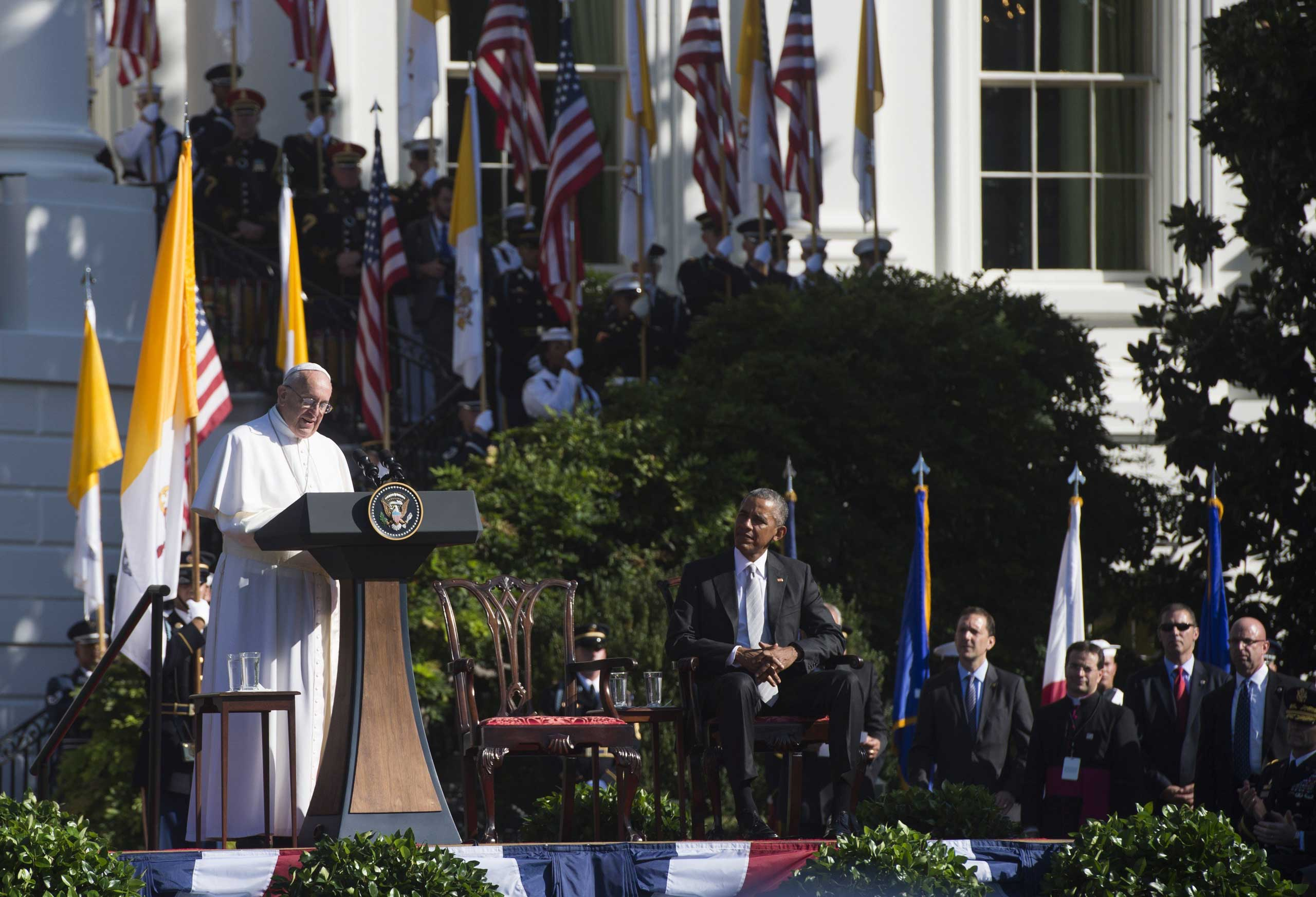 Pope Francis speaks alongside President Barack Obama during an arrival ceremony on the South Lawn of the White House in Washington, on Sept. 23, 2015.