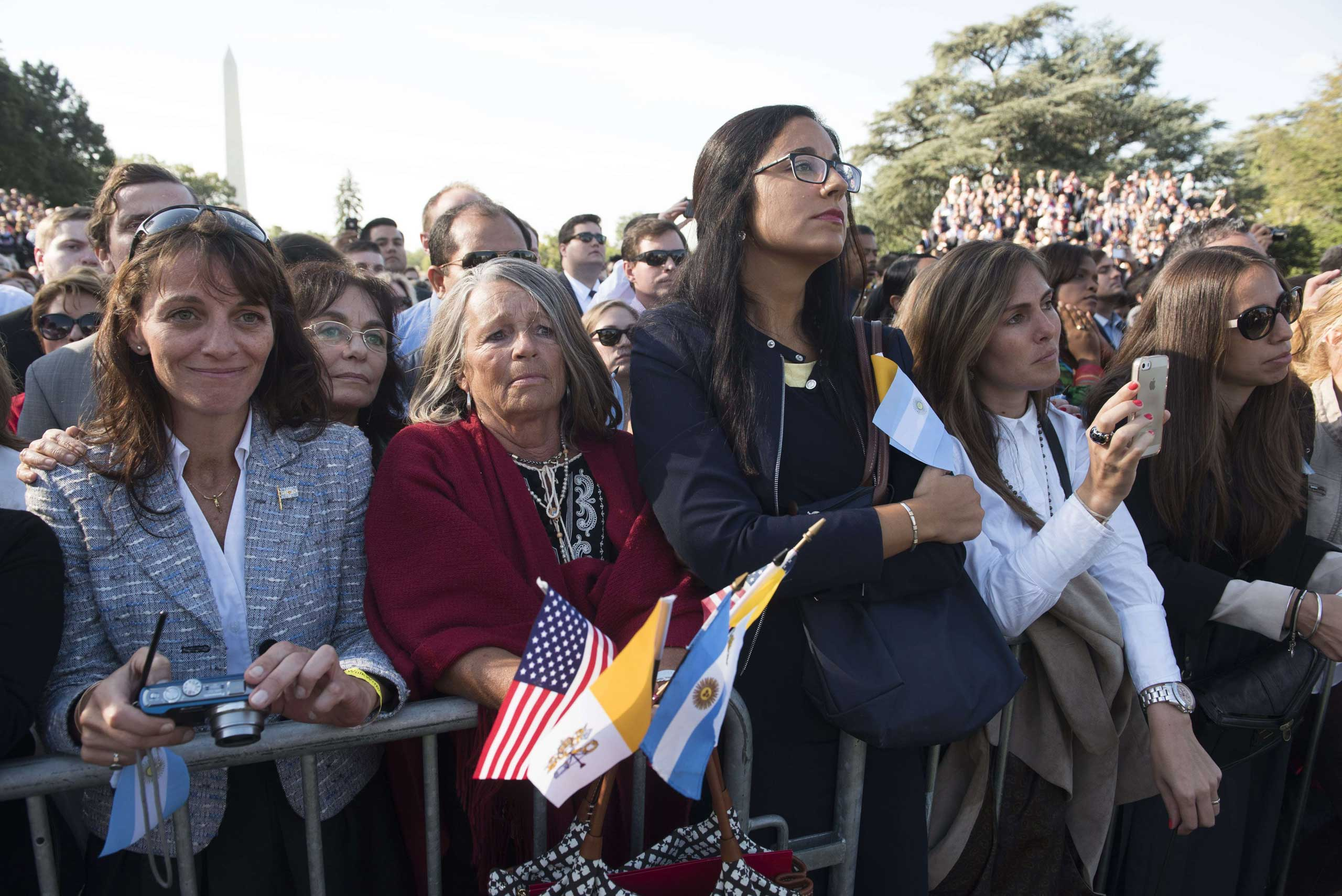 Guests watch as President Barack Obama greets Pope Francis during an arrival ceremony on the South Lawn of the White House in Washington, on Sept. 23, 2015.