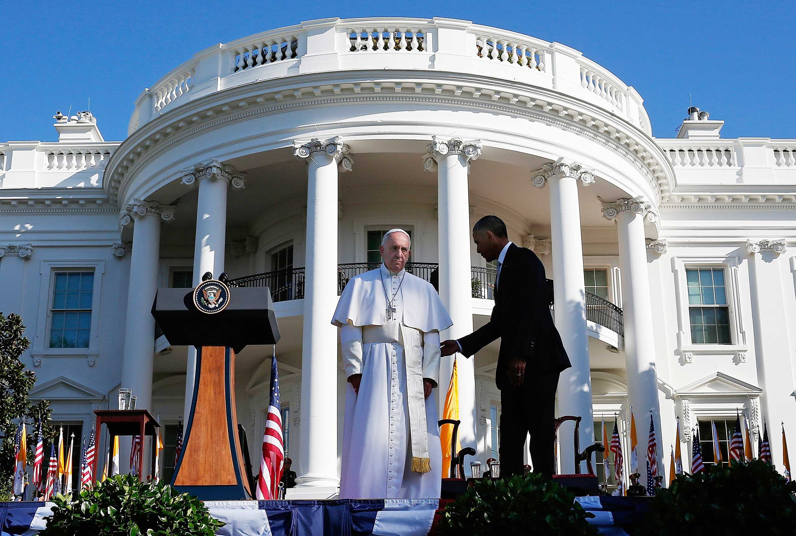 President Barack Obama welcomes Pope Francis during an arrival ceremony at the White House in Washington, on Sept. 23, 2015.