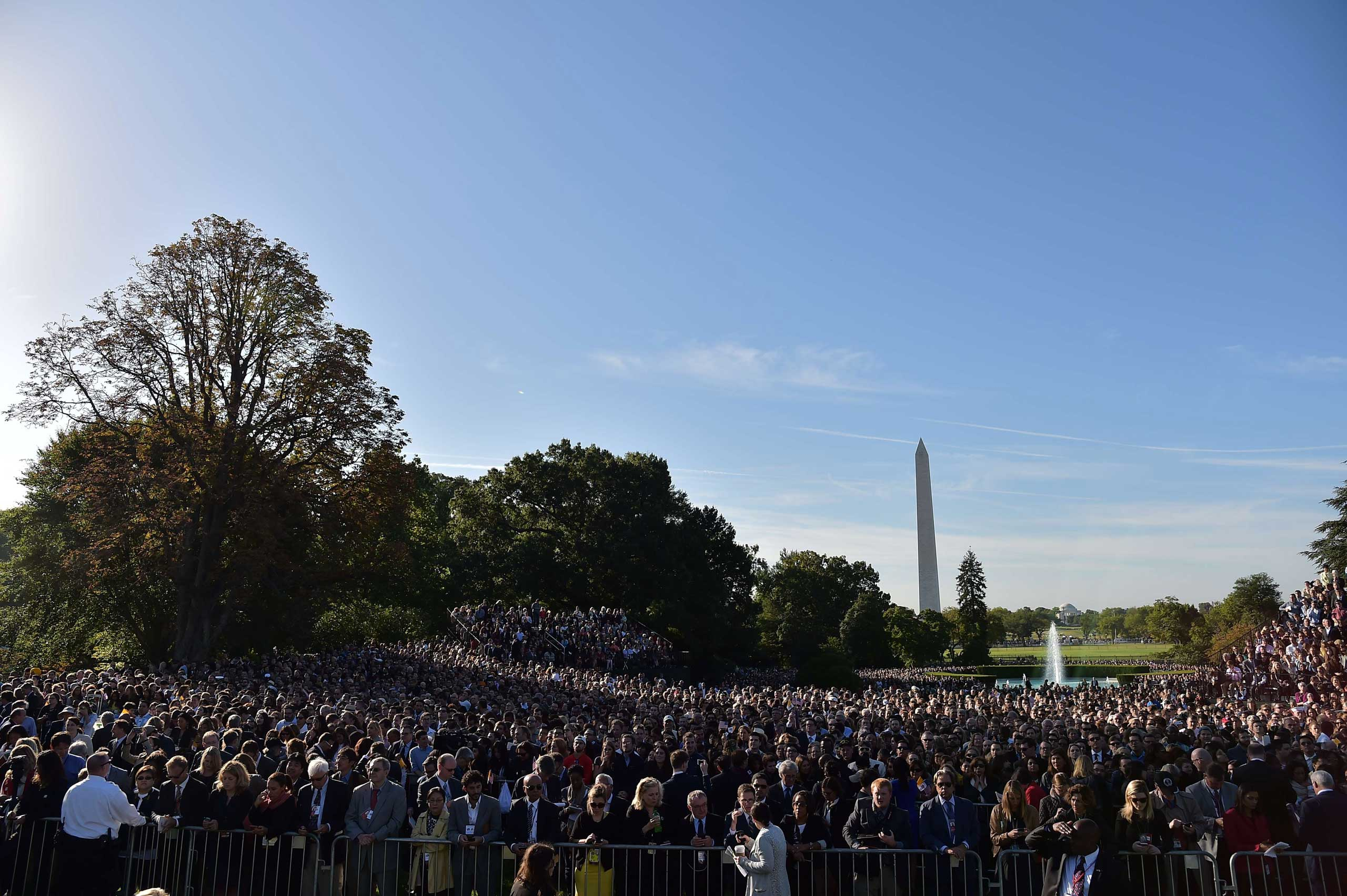 People wait for the arrival of Pope Francis at the White House in Washington, on Sept. 23, 2015.