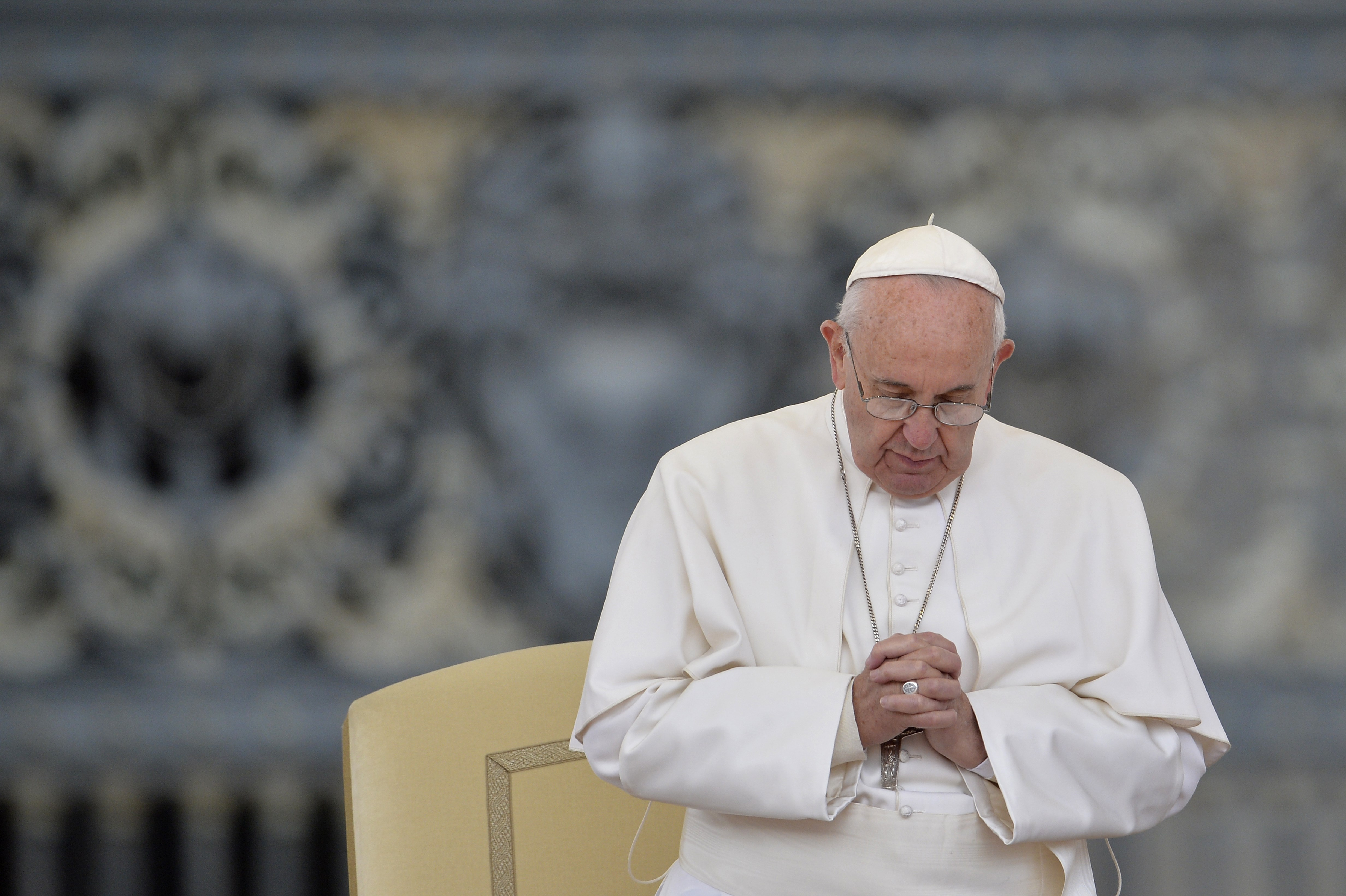 Pope Francis prays during his weekly general audience at St Peter's square on Sept. 30, 2015 at the Vatican.