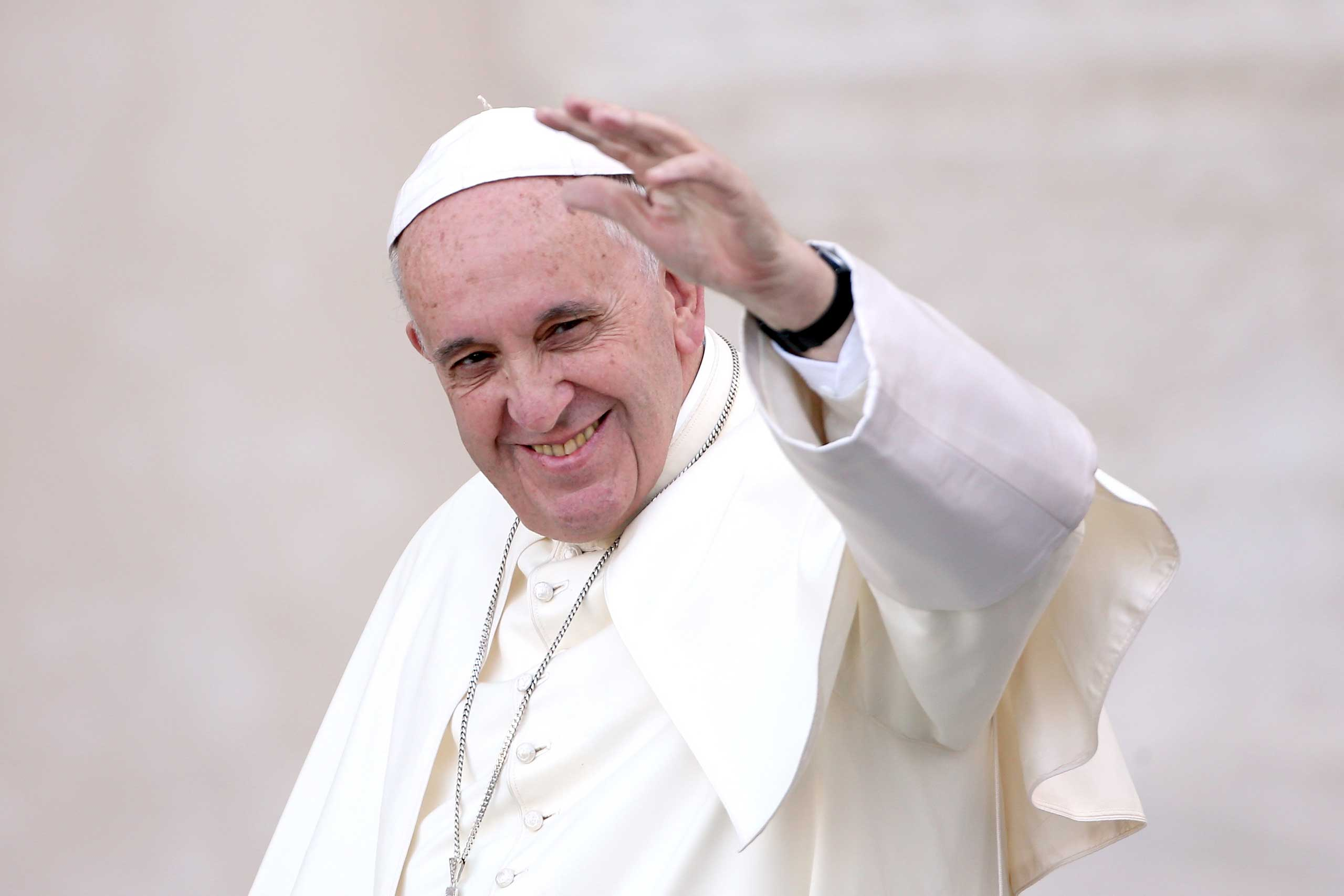 Pope Francis waves as he arrives in St. Peter's Square for an audience with thousands of altar servers from around Europe on August 4, 2015 in Vatican City, Vatican.