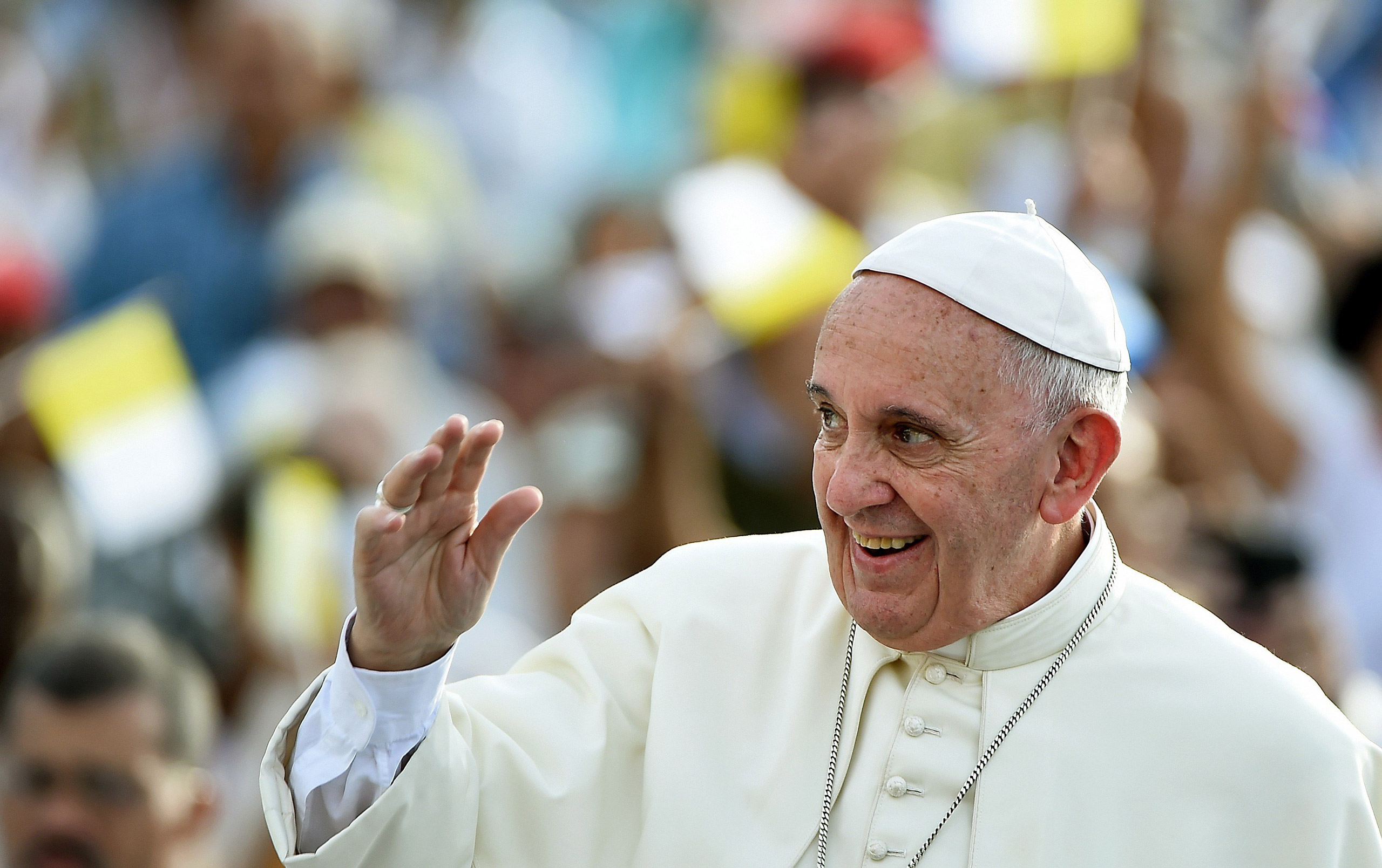 Pope Francis waves upon his arrival in Santiago de Cuba on Sept. 21, 2015.