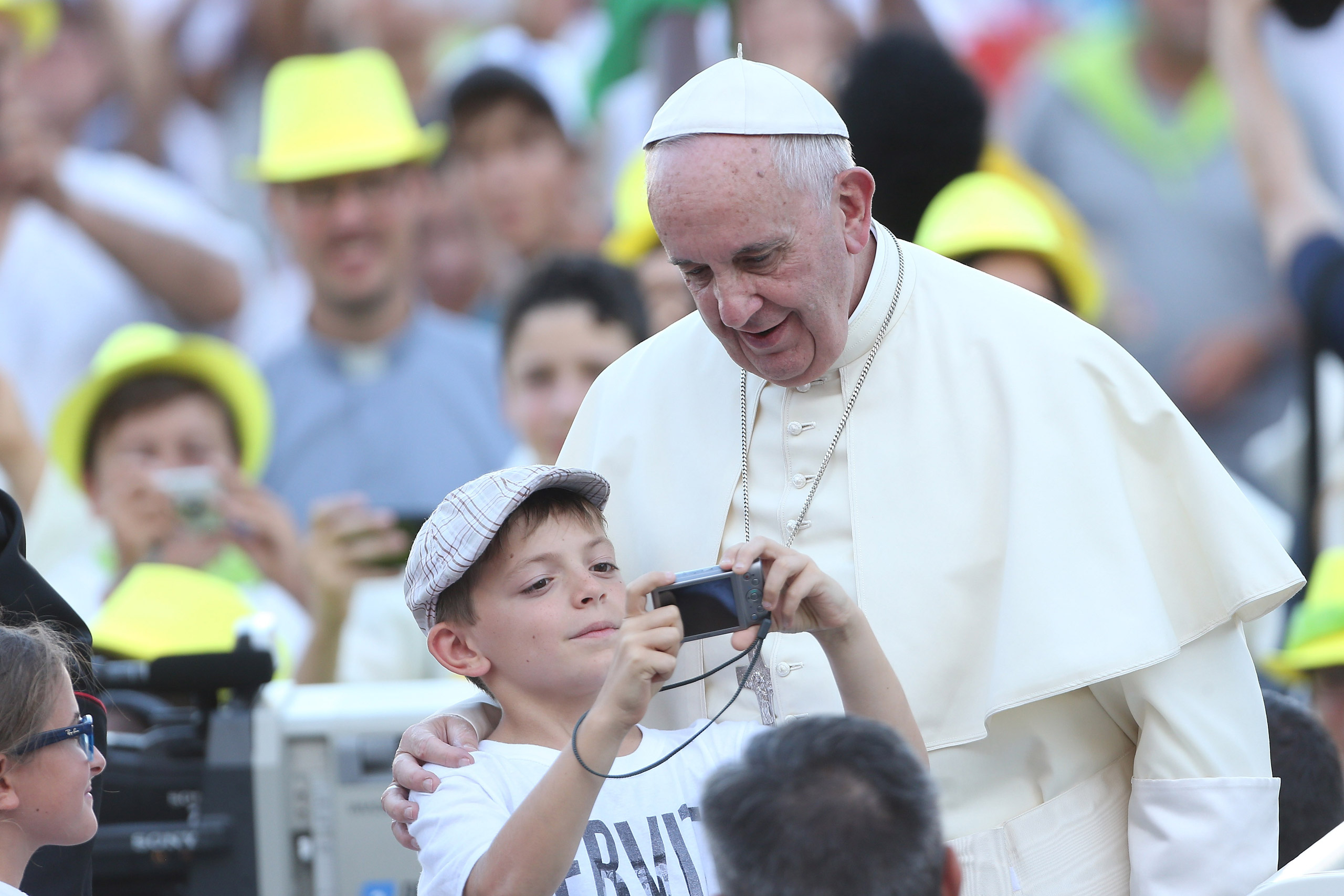 Pope Francis poses for a selfie as he arrives in St. Peter's Square for an audience in Vatican City on Aug. 4, 2015.
