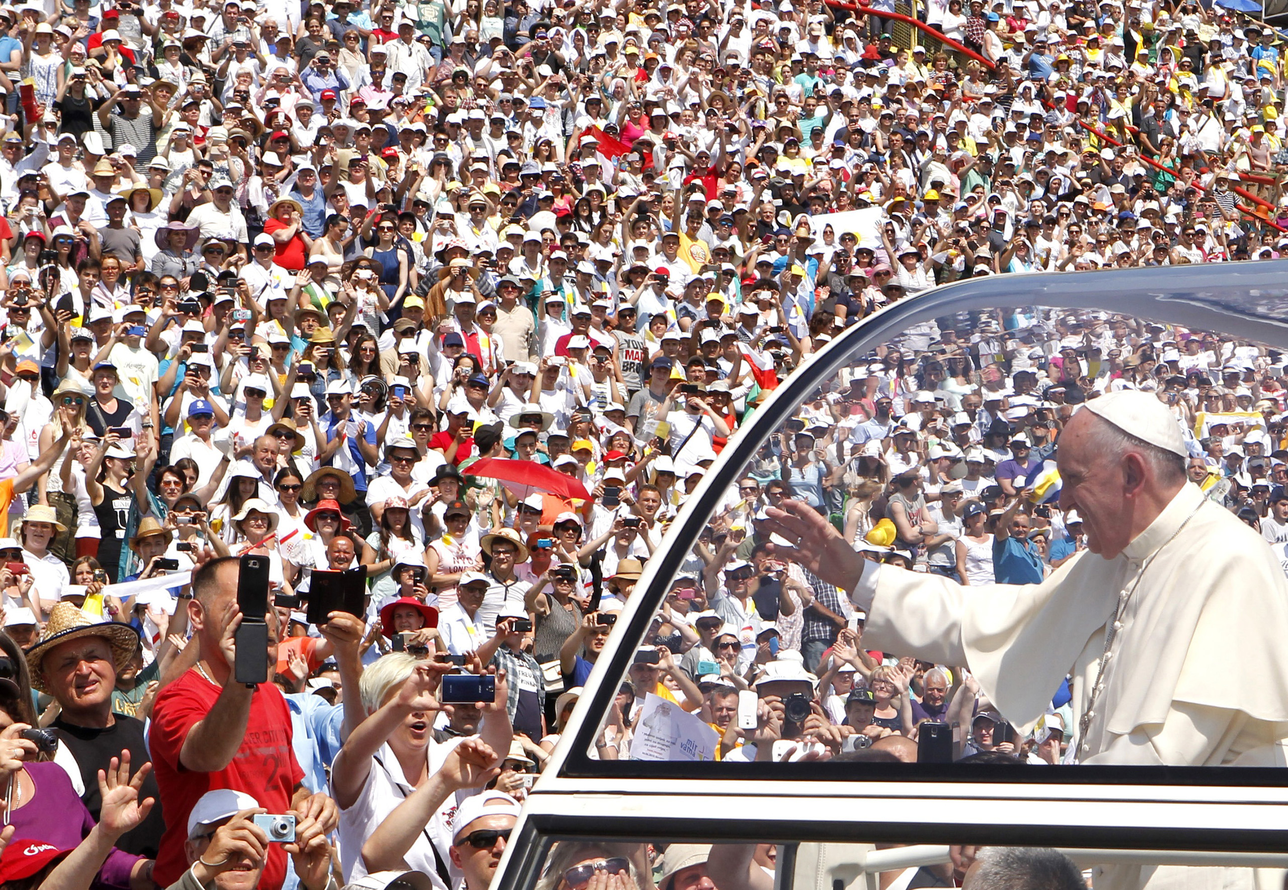Pope Francis waves to the crowd as he arrives in Bosnia and Herzegovina for a Mass in 2015.
