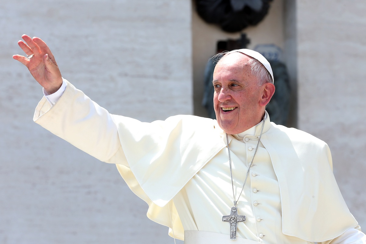 Pope Francis waves to the boy scouts gathered in St. Peter's Square on June 13, 2015 in Vatican City, Vatican.