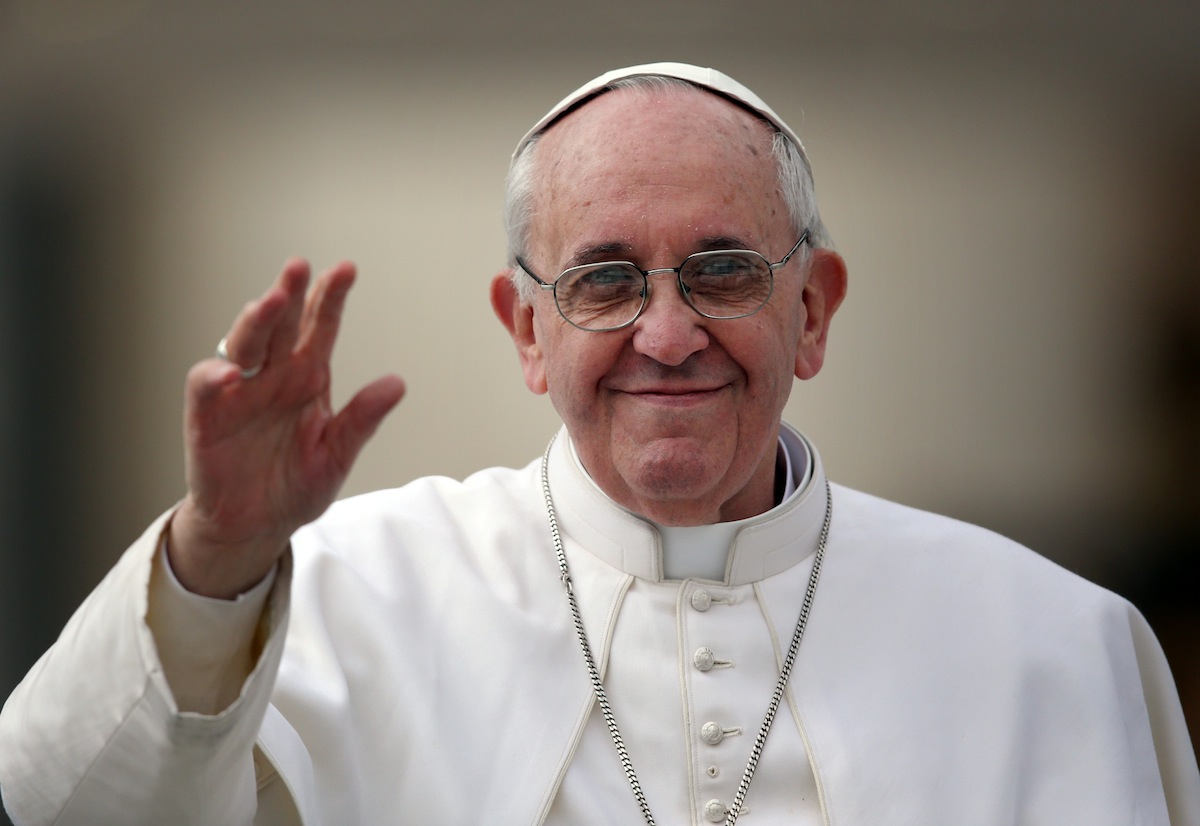 Pope Francis waves to the crowd as he drives around St Peter's Square ahead of his first weekly general audience as pope on March 27, 2013 in Vatican City.