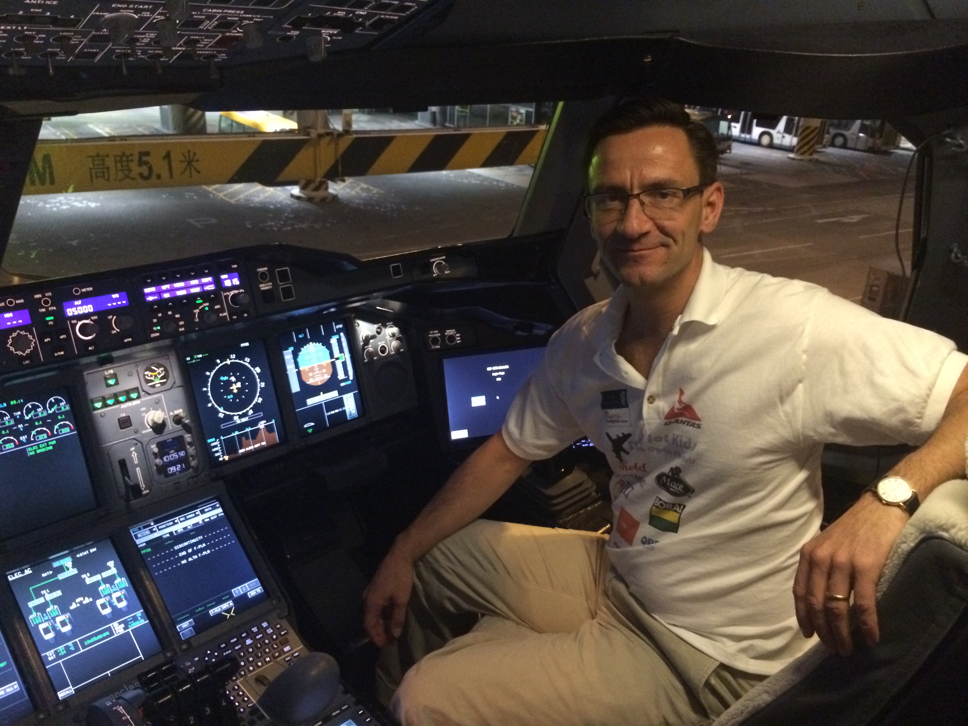 This undated photo shows Matthias Fuchs in the cockpit of an Airbus A380 at Hong Kong International Airport.