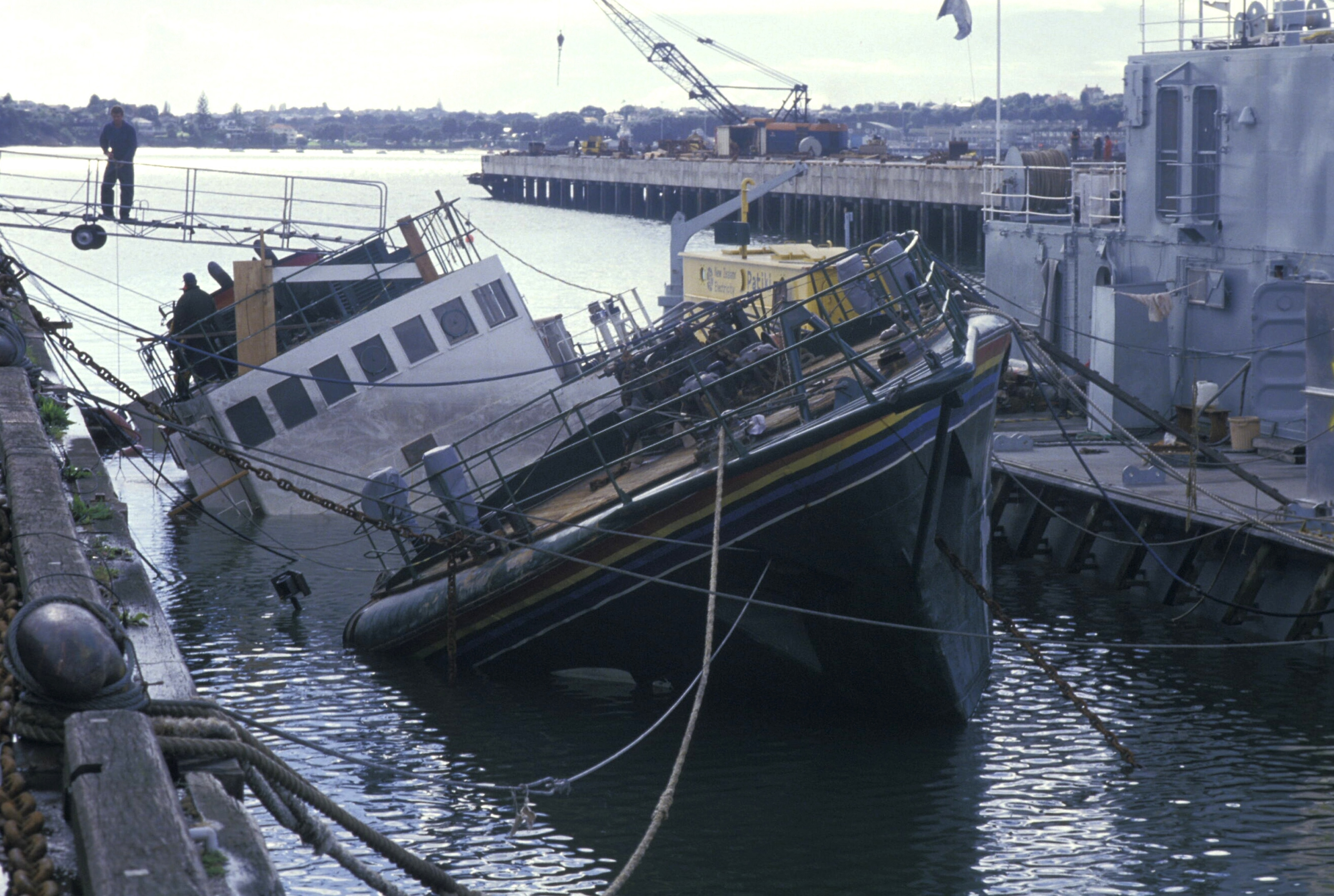 Greenpeace Rainbow Warrior sinking in the Bay of Auckland in New Zealand, 1985.