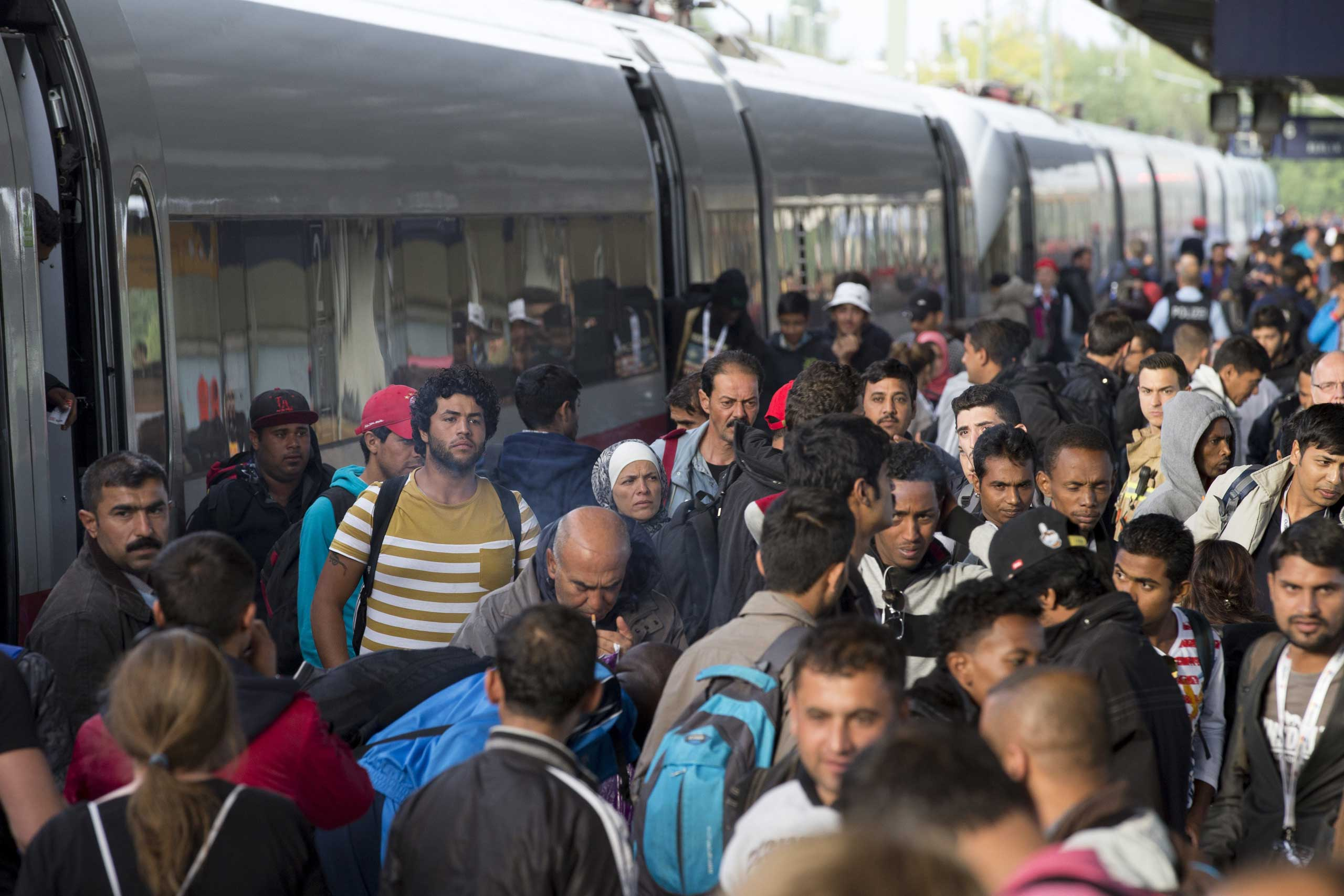 Refugees get out of a special train coming from Munich upon arrival at the railway station in Berlin Schoenefeld, on Sept. 13, 2015.