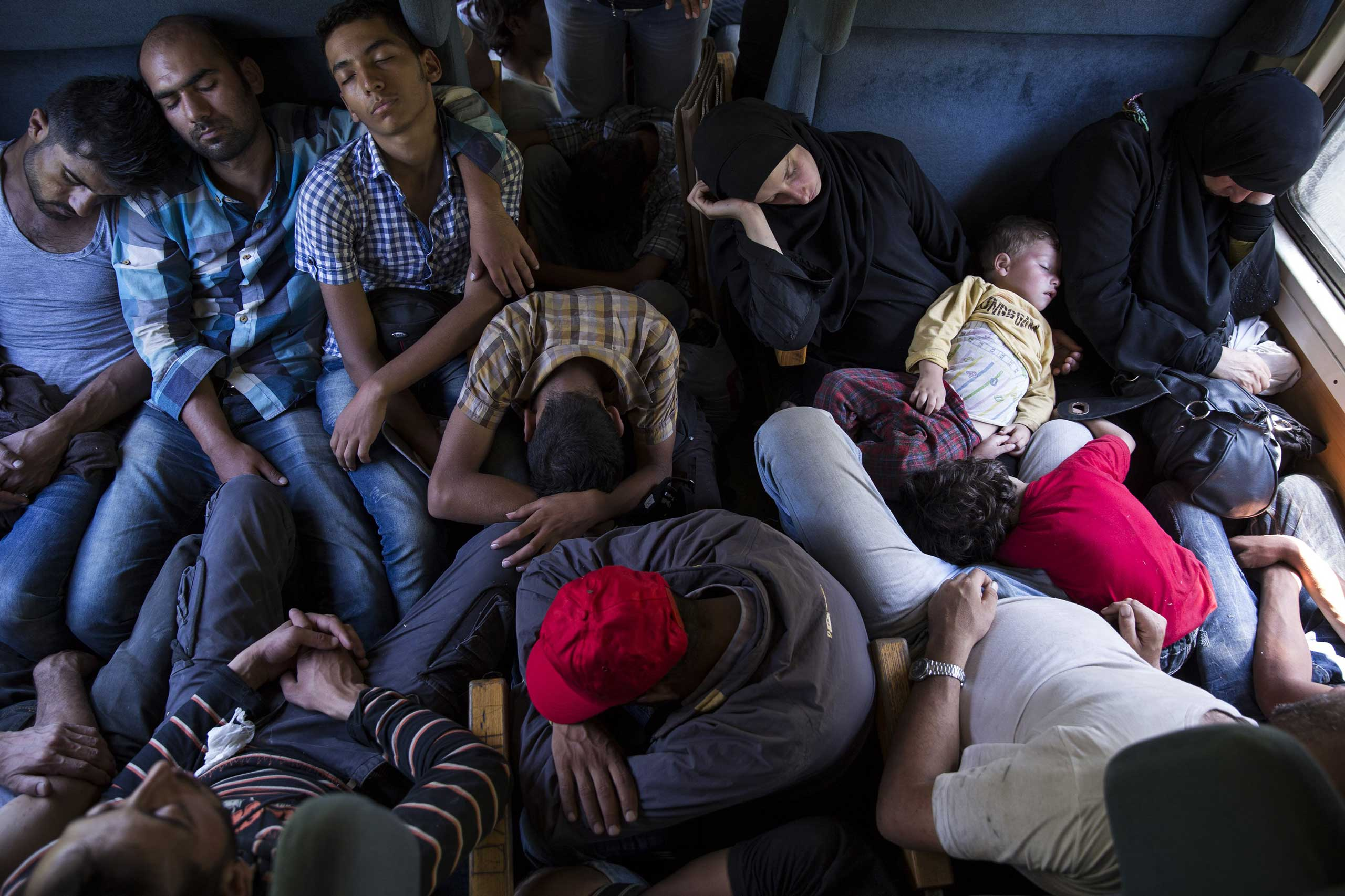 Migrant families ride a train from Gevgelija to the Serbian border in Macedonia, on Sept. 4, 2015.