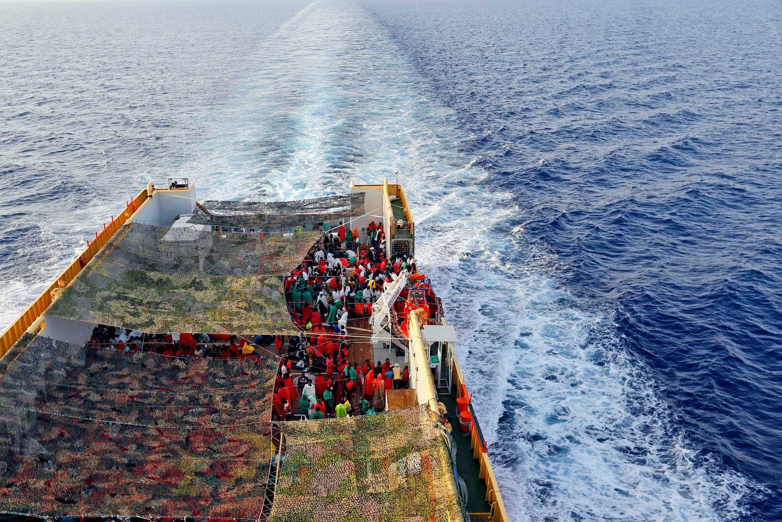 Migrants crowd the bridge of the Norwegian Siem Pilot ship sailing along the Mediterranean sea, on Sept. 2, 2015.