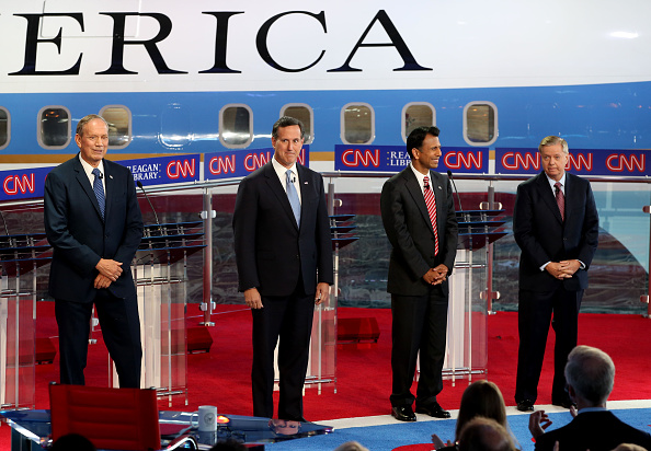 Republican presidential candidates  former NY Governor George Pataki,former PA Senator Rick Santorum,LA Governor Bobby Jindal and SC Senator Lindsey Graham onstage during the Republican presidential debates at the Reagan Library in Simi Valley on September 16, 2015.