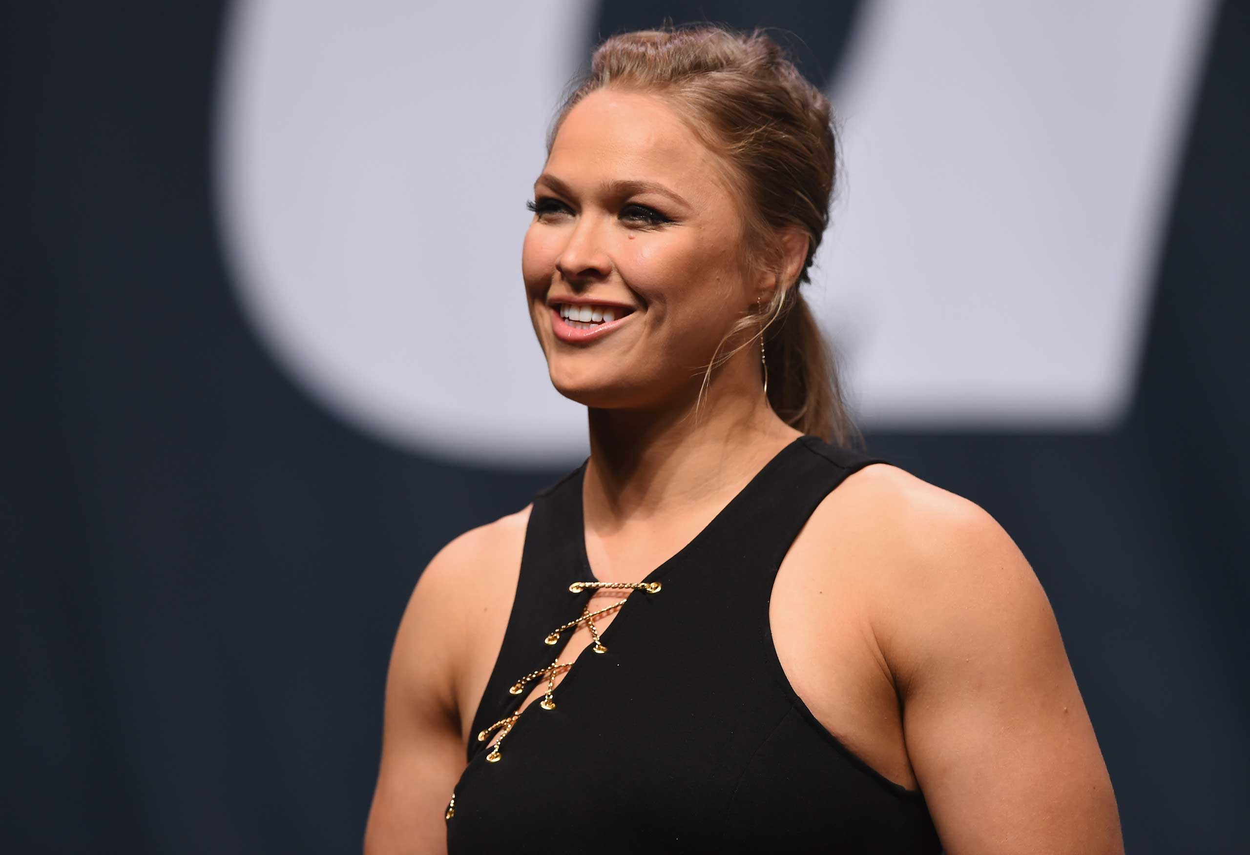 UFC women's bantamweight champion Ronda Rousey speaks to the fans during the UFC's Go Big launch event inside MGM Grand Garden Arena on September 4, 2015 in Las Vegas.