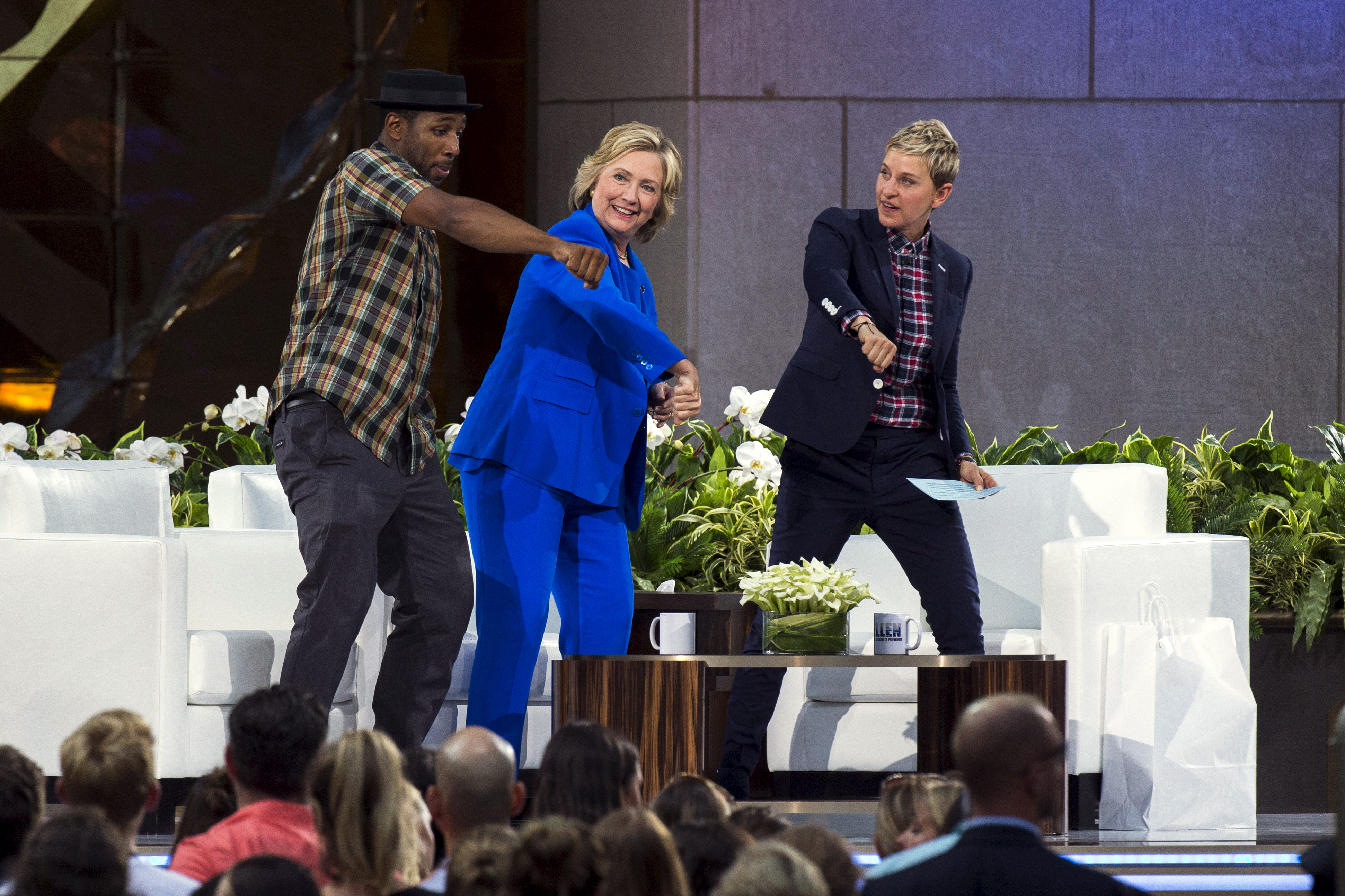 U.S. Democratic presidential candidate Hillary Clinton dances with DJ Stephen  Twitch  Boss, left, and television host Ellen DeGeneres, right, during a taping of The Ellen DeGeneres Show in New York Sept. 8, 2015