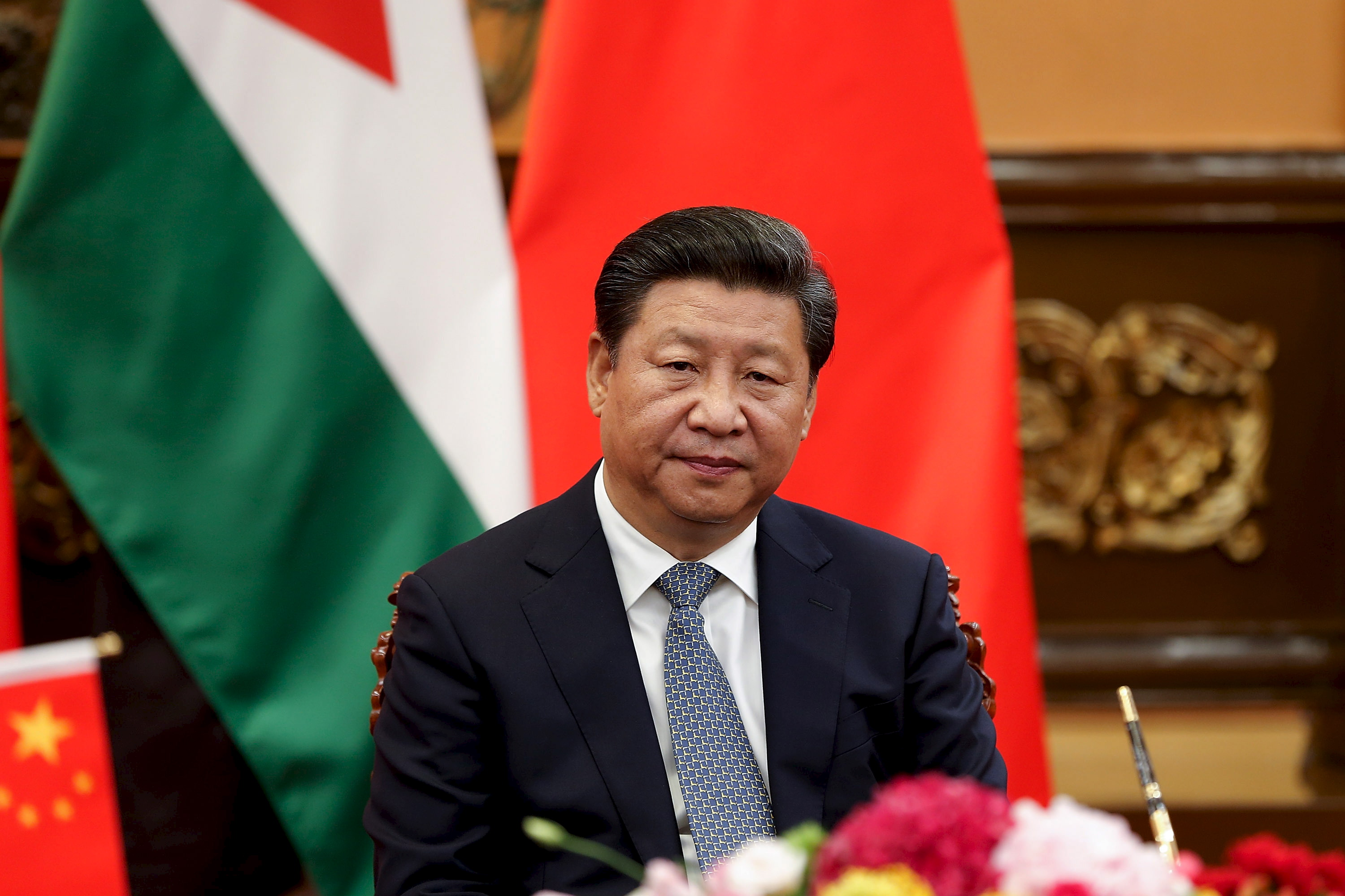 China's President Xi Jinping attends a signing ceremony with King of Jordan Abdullah II (not pictured) at he Great Hall of the People in Beijing on Sept. 9, 2015