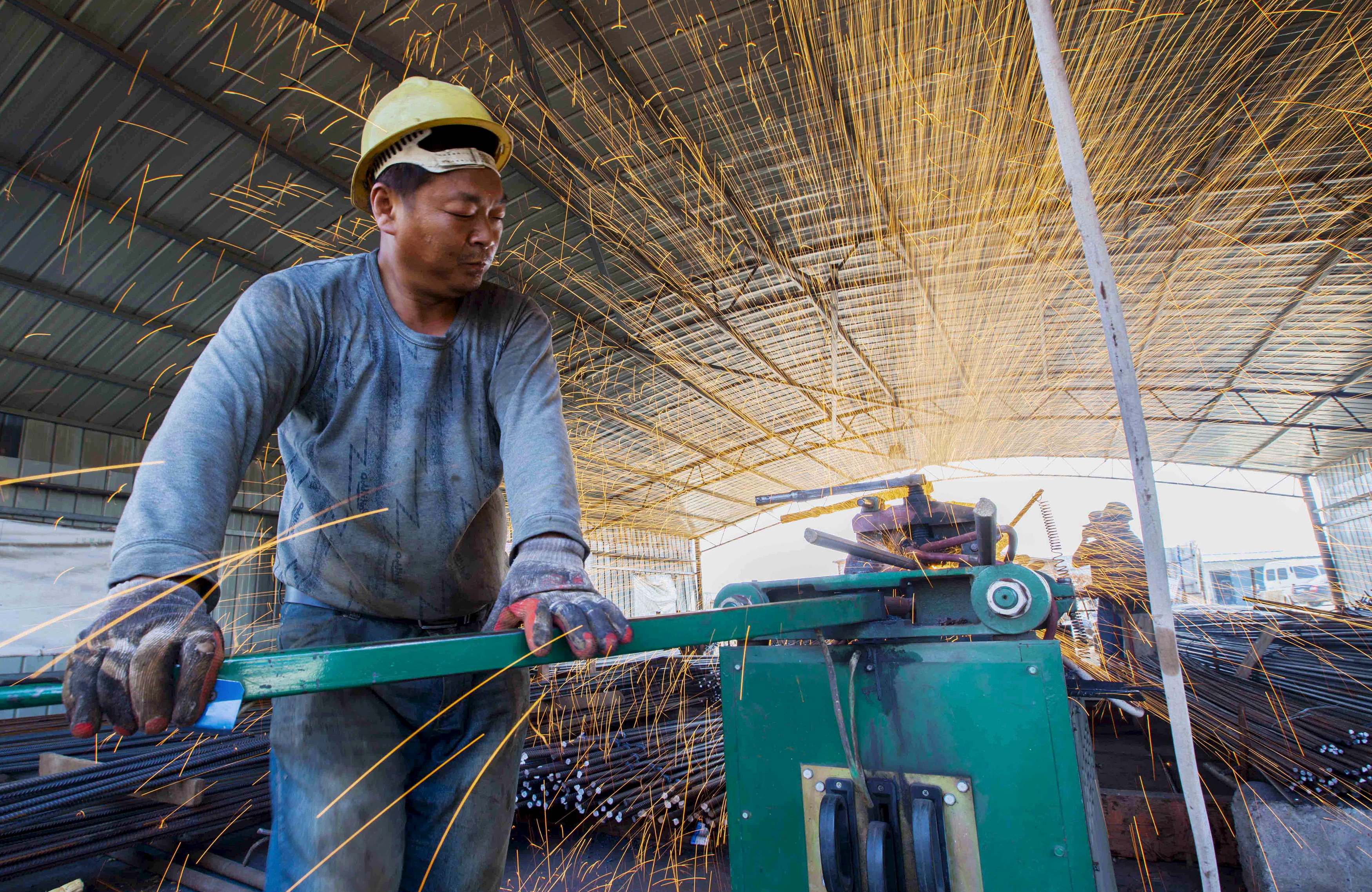 A laborer cuts steel bars at a railway-bridge construction site in Lianyungang, in the Chinese province of Jiangsu, on Sept. 12, 2015
