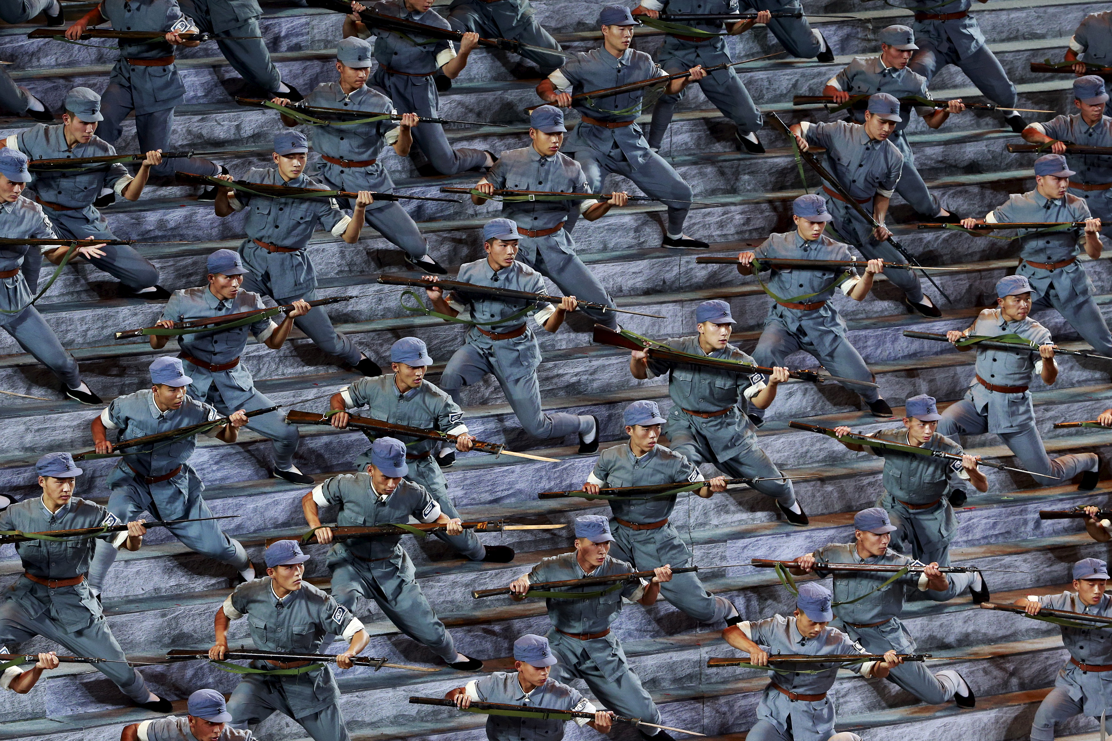 Actors dressed as Red Army soldiers perform at a gala show to mark the 70th anniversary of the end of World War II in Beijing on Sept. 3, 2015