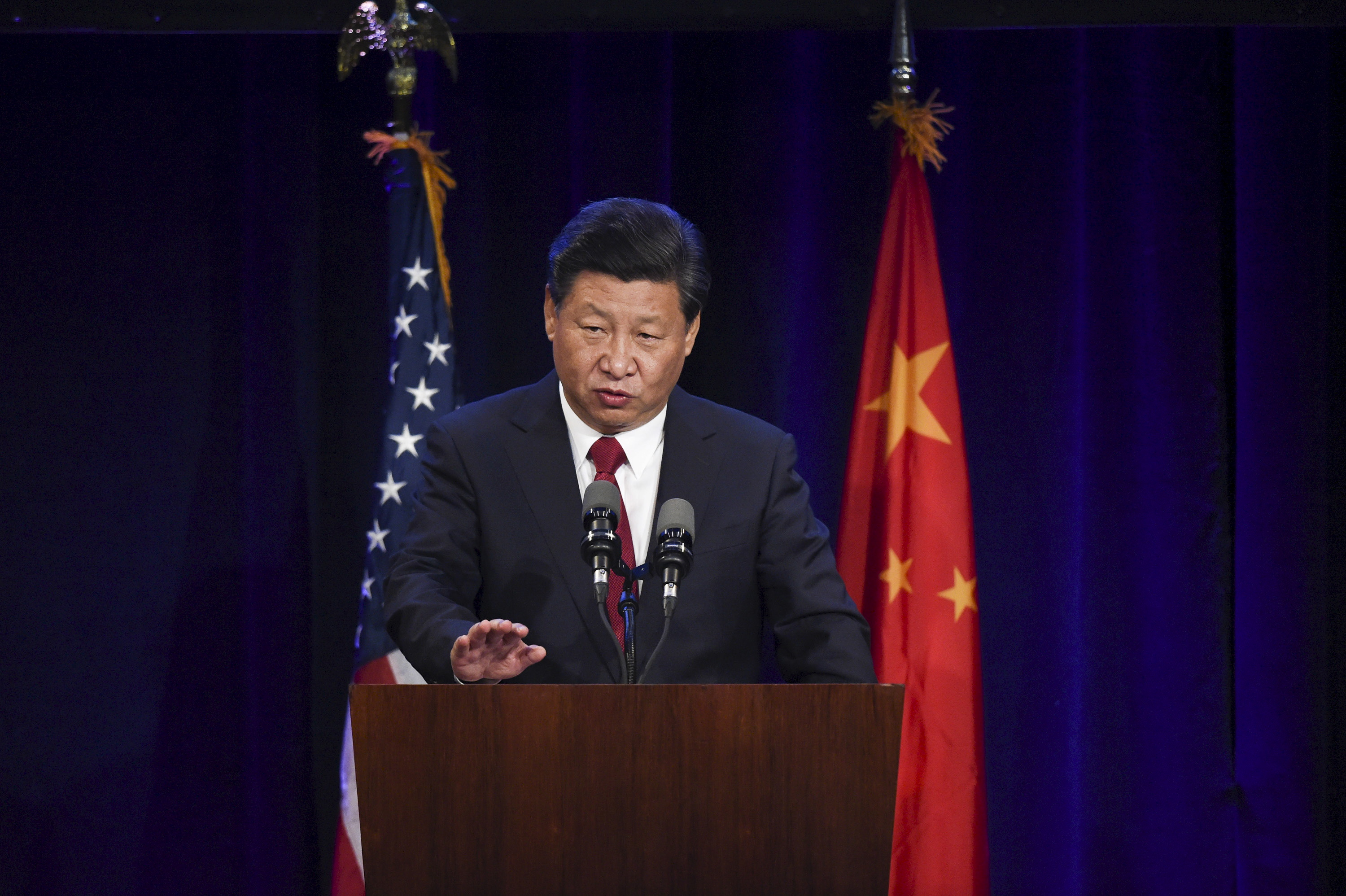 Chinese President Xi Jinping delivers a policy speech to Chinese and United States CEOs during a dinner reception in Seattle, Washington Sept. 22, 2015