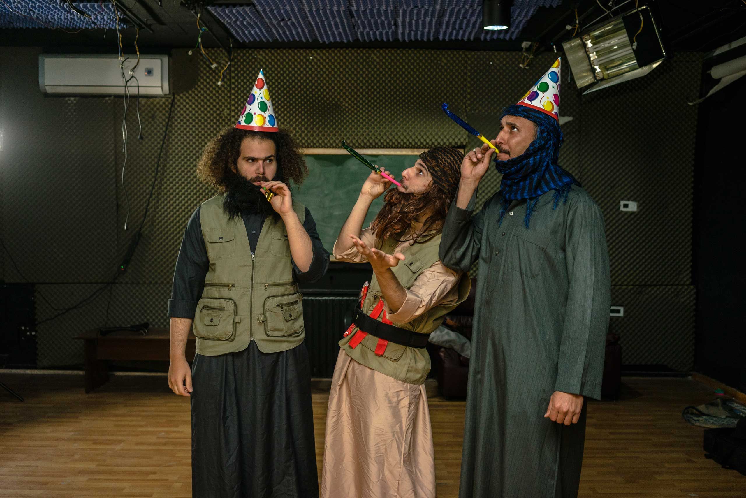 Three actors, Alhakam Turki, Shwan Sarheng and Mustafa Saedi, rehearse for a sketch on the set of the Al-Basheer Show in Amman
