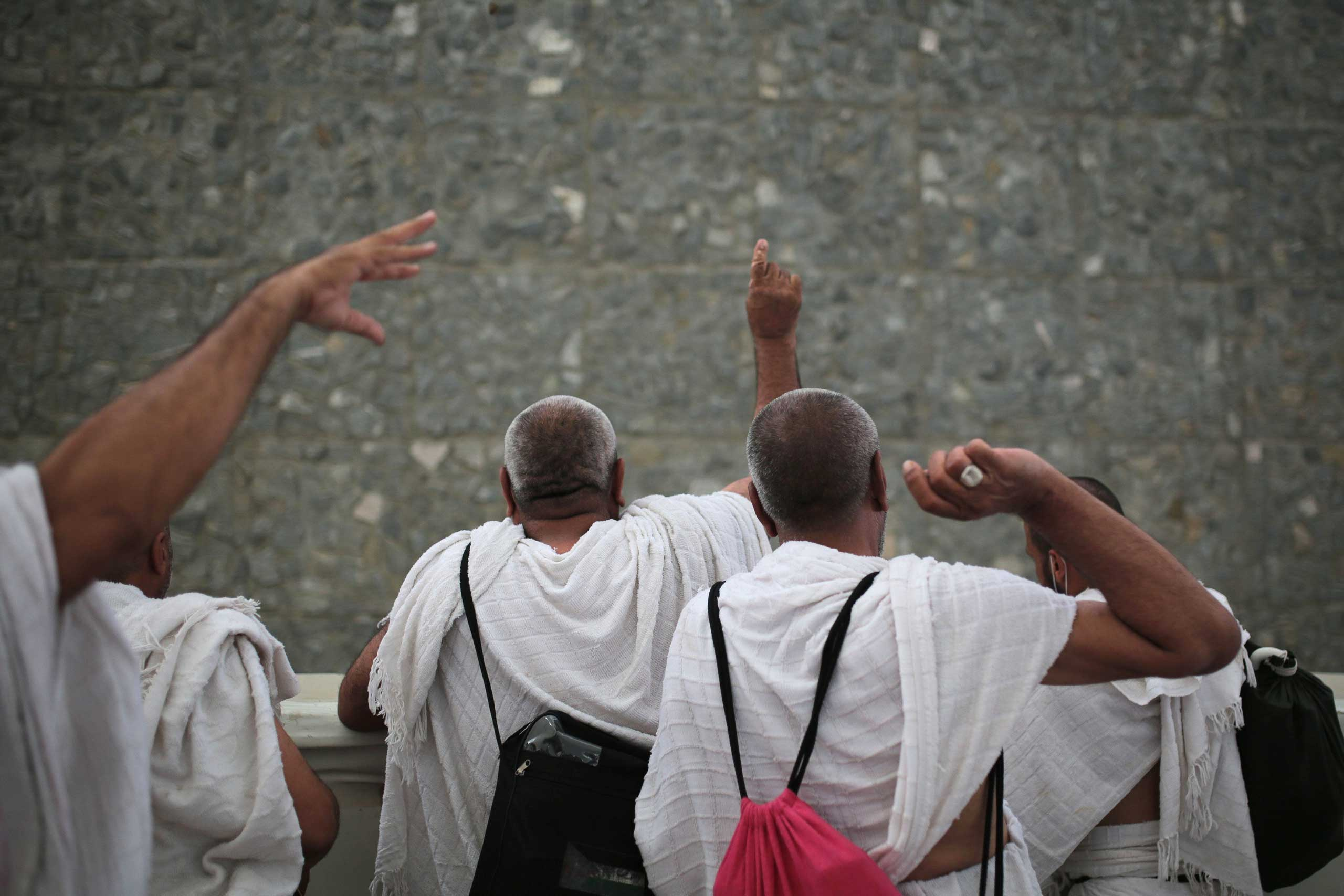 Muslim pilgrims cast stones at a pillar symbolizing the stoning of Satan, in a ritual called  Jamarat,  the last rite of the annual hajj, on the first day of Eid al-Adha, in Mina near the holy city of Mecca, on Sept. 24, 2015.