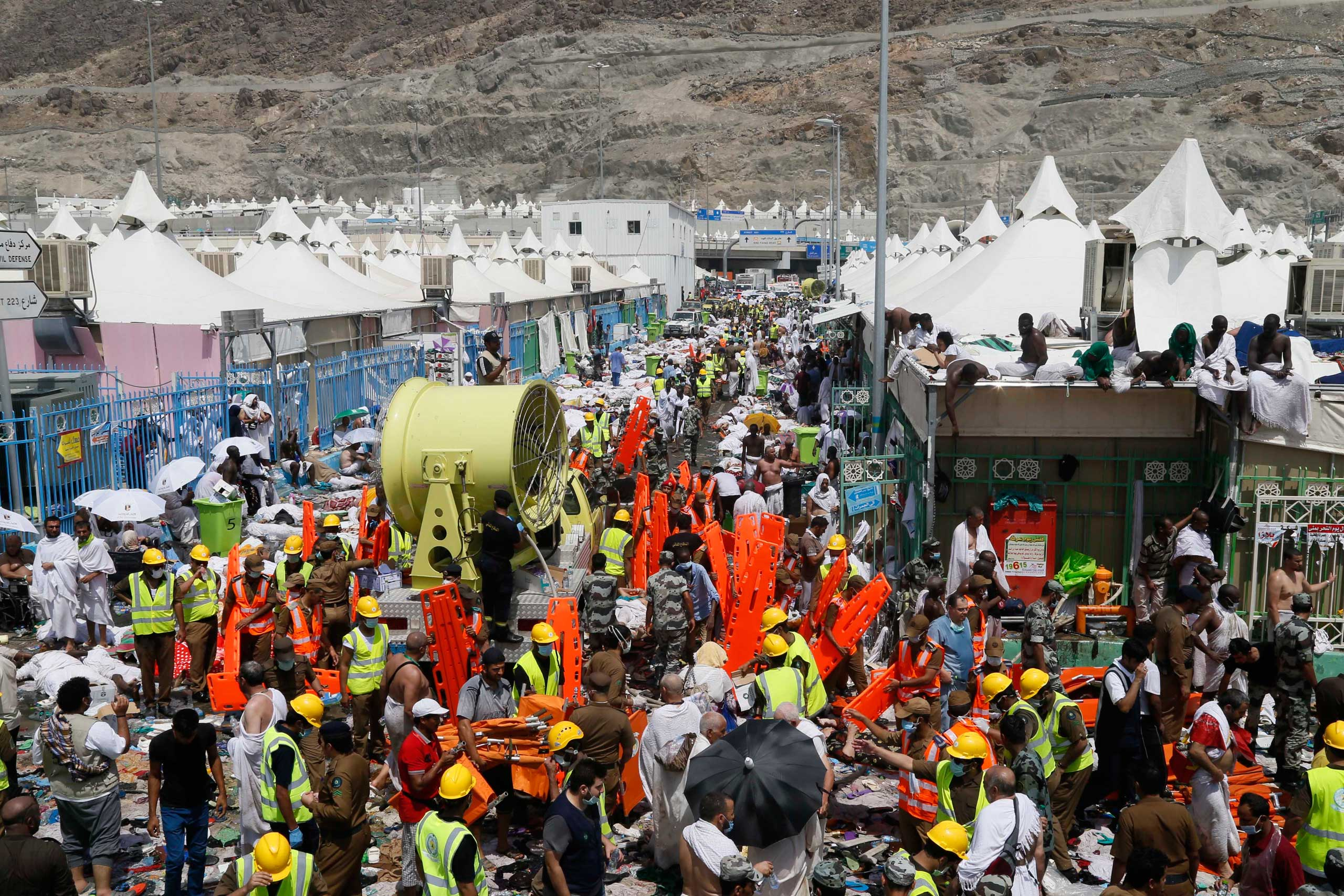 Muslim pilgrims and rescuers gather around people who died in Mina, Saudi Arabia during the annual hajj pilgrimage on Sept. 24, 2015.
