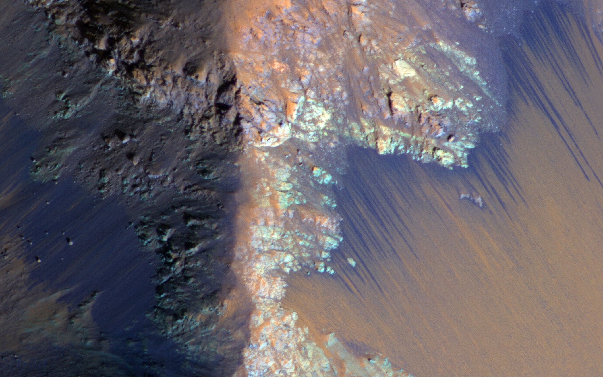 RSL may be due to active seeps of water. These dark flows are abundant along the steep slopes of ancient bedrock in Coprates Chasma. Acquired on Dec. 31, 2013.