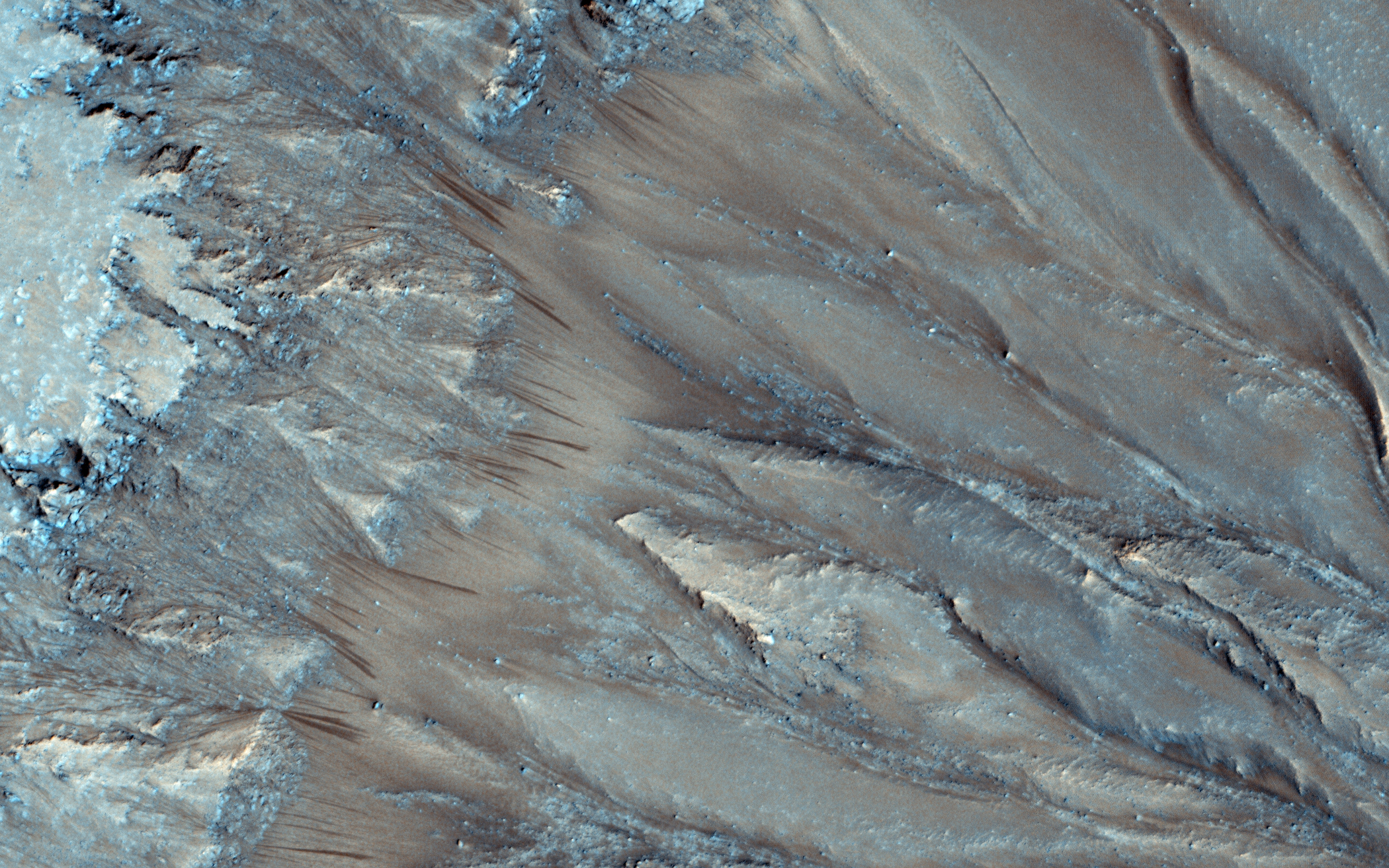 Seasonal flows on Palikir Crater, a warm Martian slopes, that may be caused by the flow of salty water on Mars. Acquired on March 15, 2013