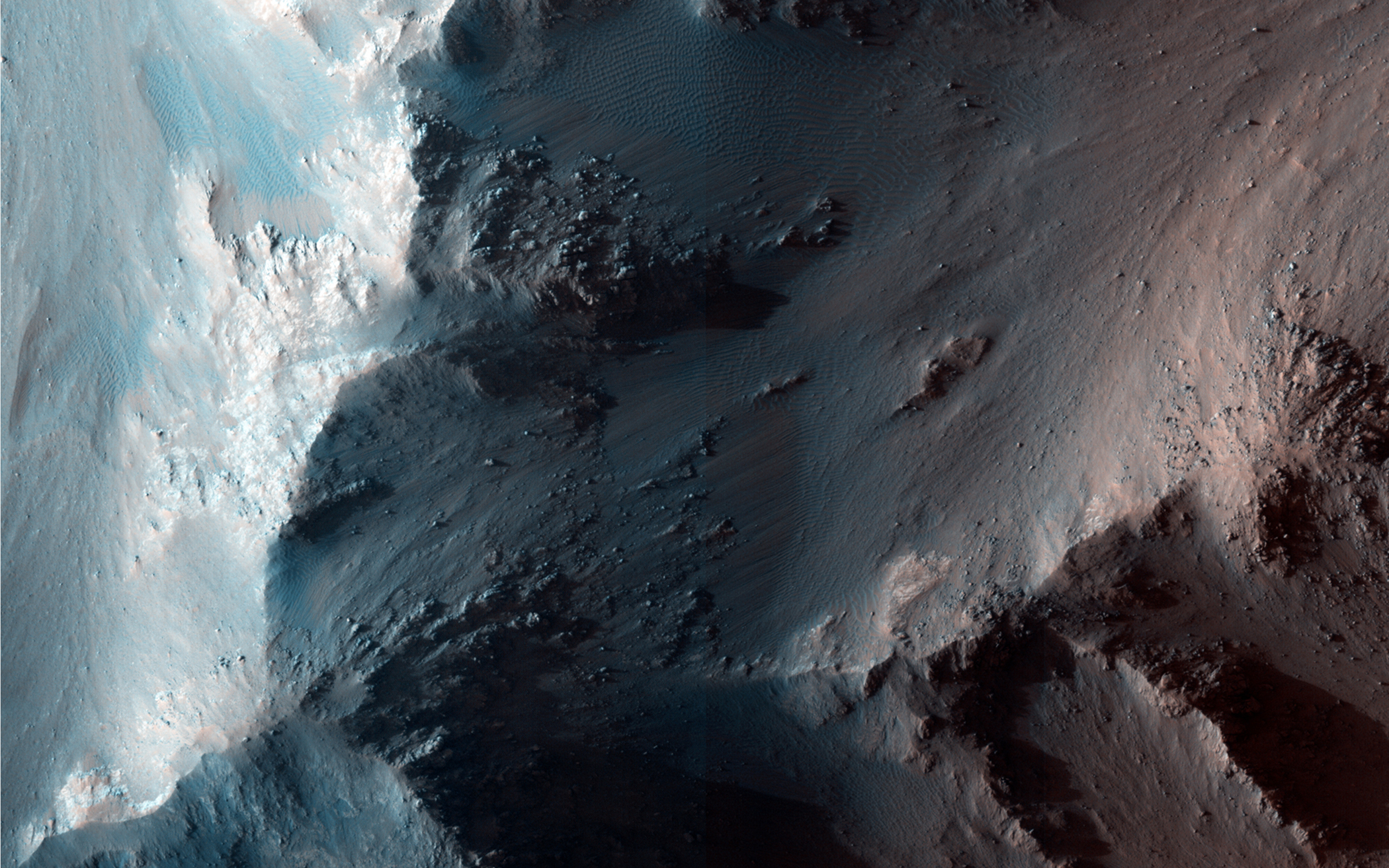 This image displays a site along a Coprates Chasma ridge shows RSL on generally north-facing slopes, acquired on Oct. 20, 2012.
