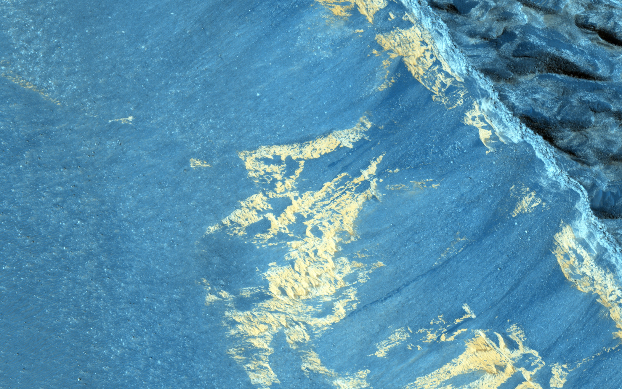 Recurring slope lineae (RSL) are a type of dark streak seen on Martian slopes and are thought to form from flow of liquid water.  This image shows RSL in the Aram Chaos, acquired on Jan. 11, 2015.