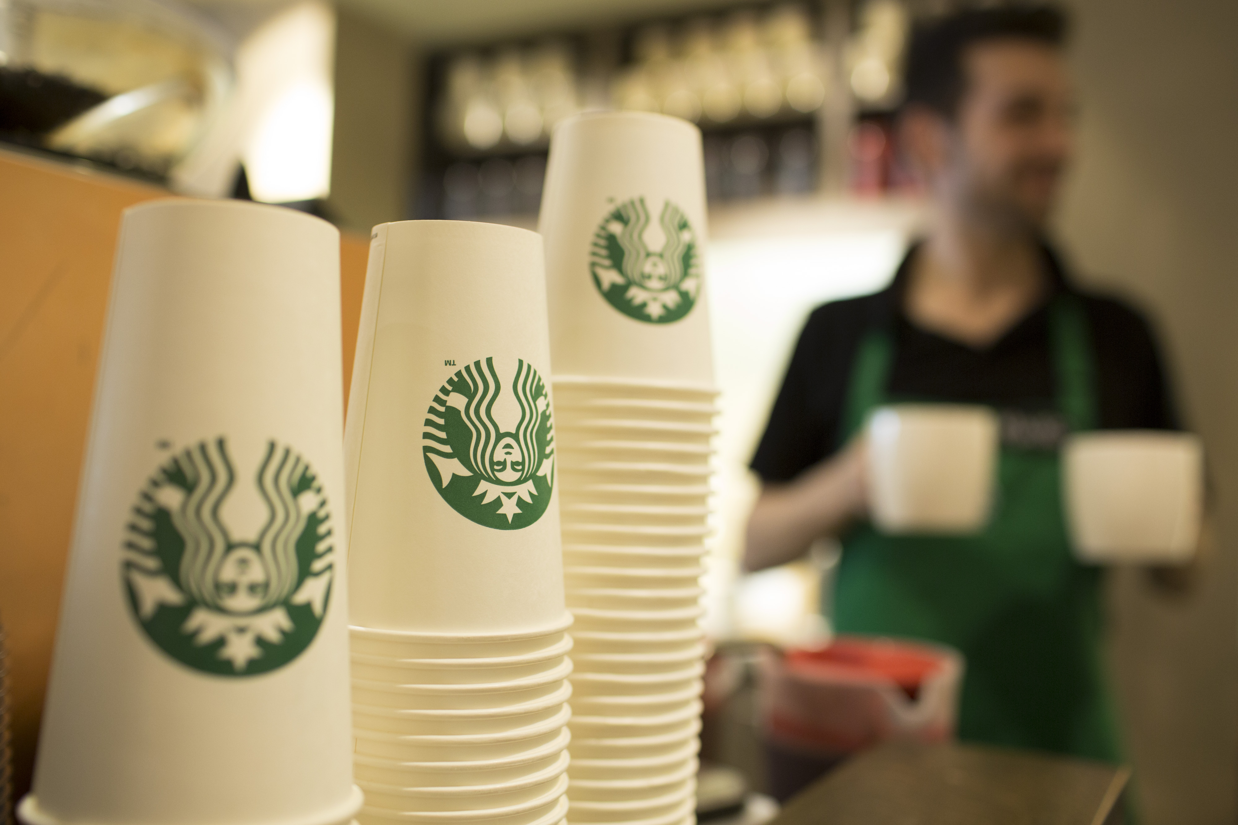 The Starbucks Corp. logo sits on cardboard coffee cups inside a Starbucks Corp. shop in London, U.K., on Monday, June 9, 2014.